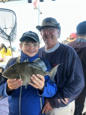 Aidan Murray got this big triggerfish while fishing aboard the Shinnecock Star out of Hampton Bays with his grandpa Bob.  Deena Lippman