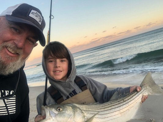 Michael and Mikey Dean picked a few keeper-sized striped bass out of the surf in Quogue this weekend.