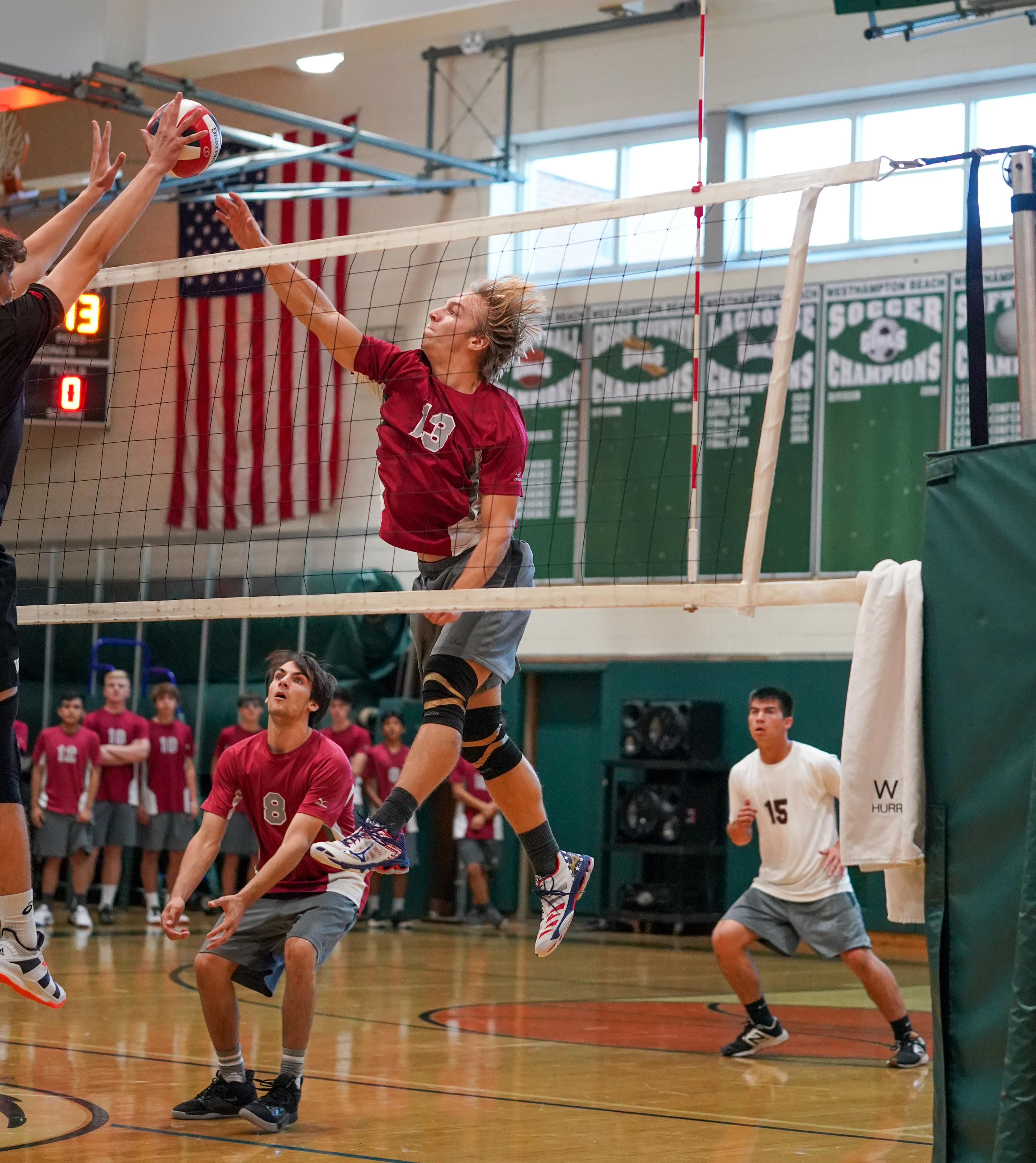 East Hampton junior Luc Campbell tries to get the ball over a Westhampton Beach block.