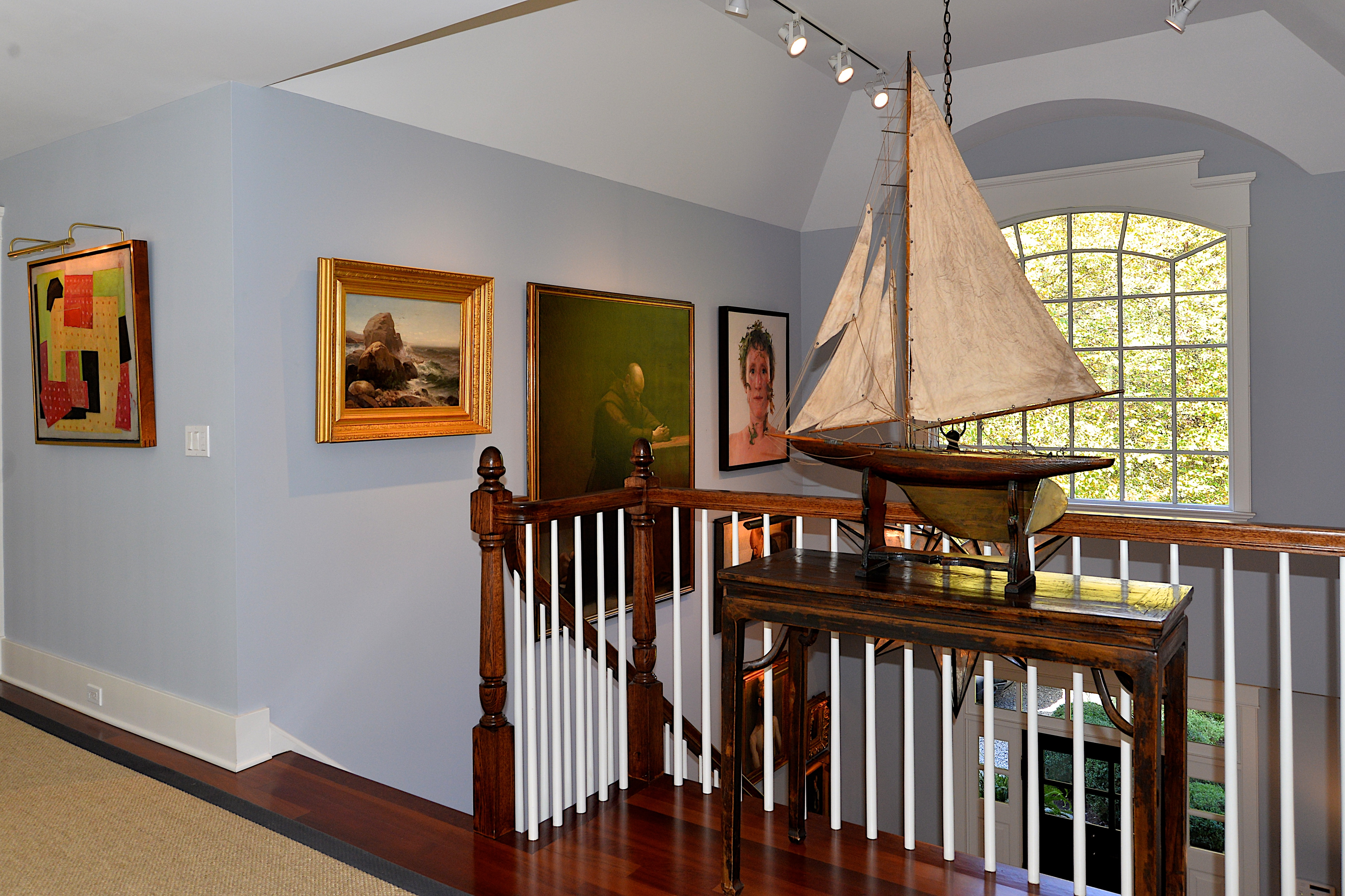 A model ship is among the antiques that adorn the home.