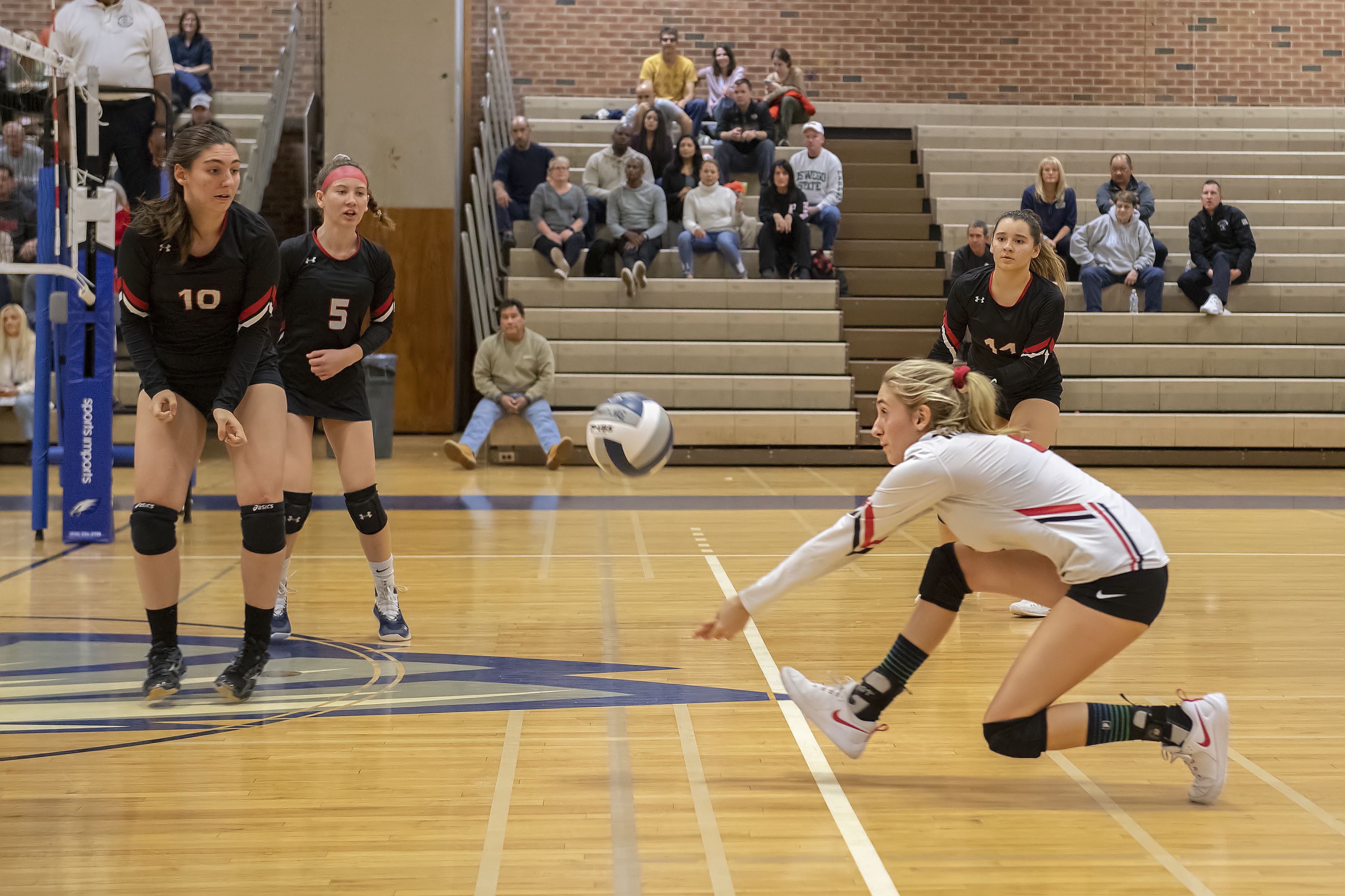 Pierson's Olivia Cassone reaches for a return as the Lady Whalers battled the Oyster Bay Lady Baymen for the Long Island Class C Volleyball Championship at Hauppauge High School on Saturday night.