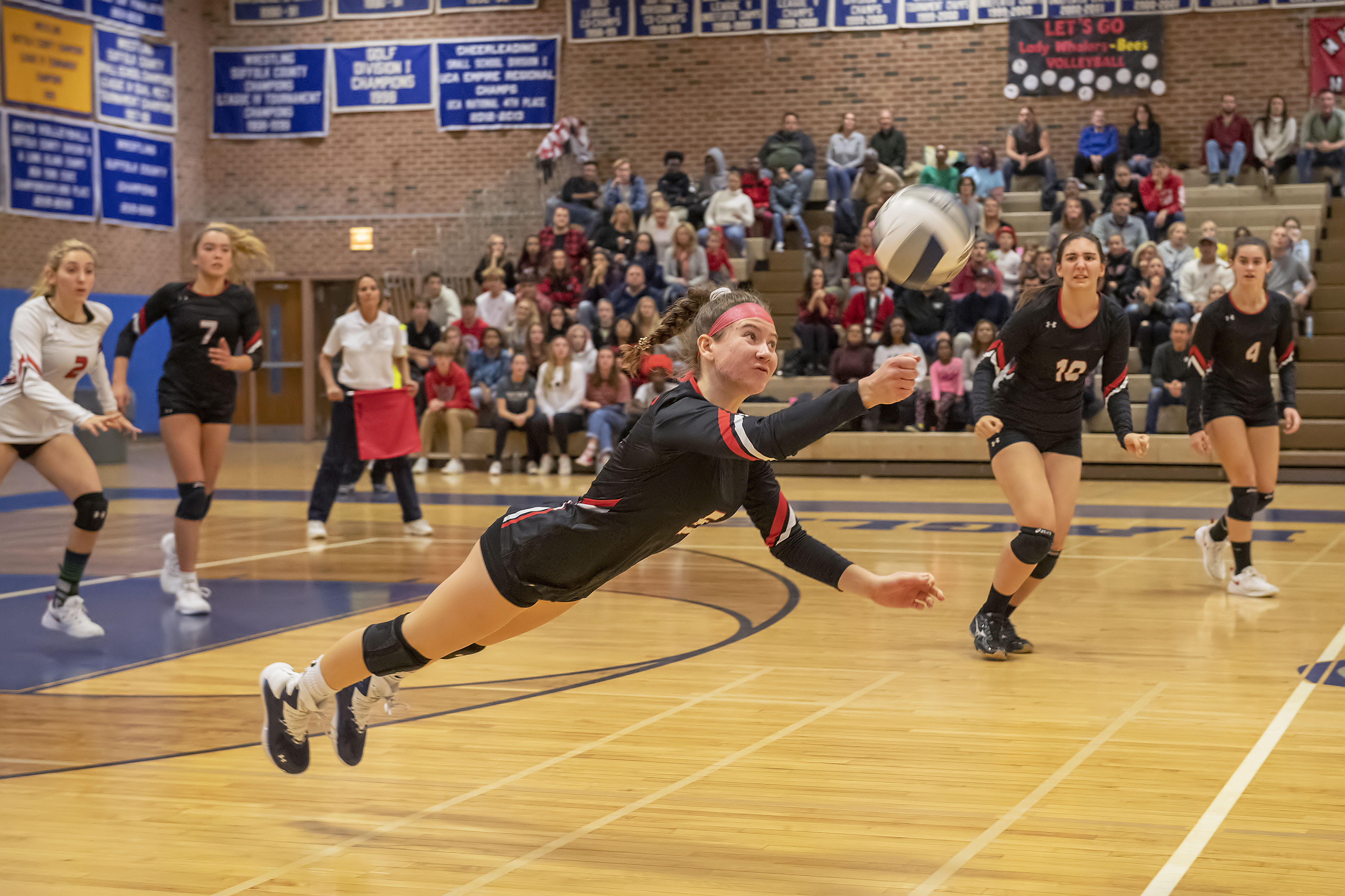 Pierson's Sophia Mancino lays herself out to record a dig.