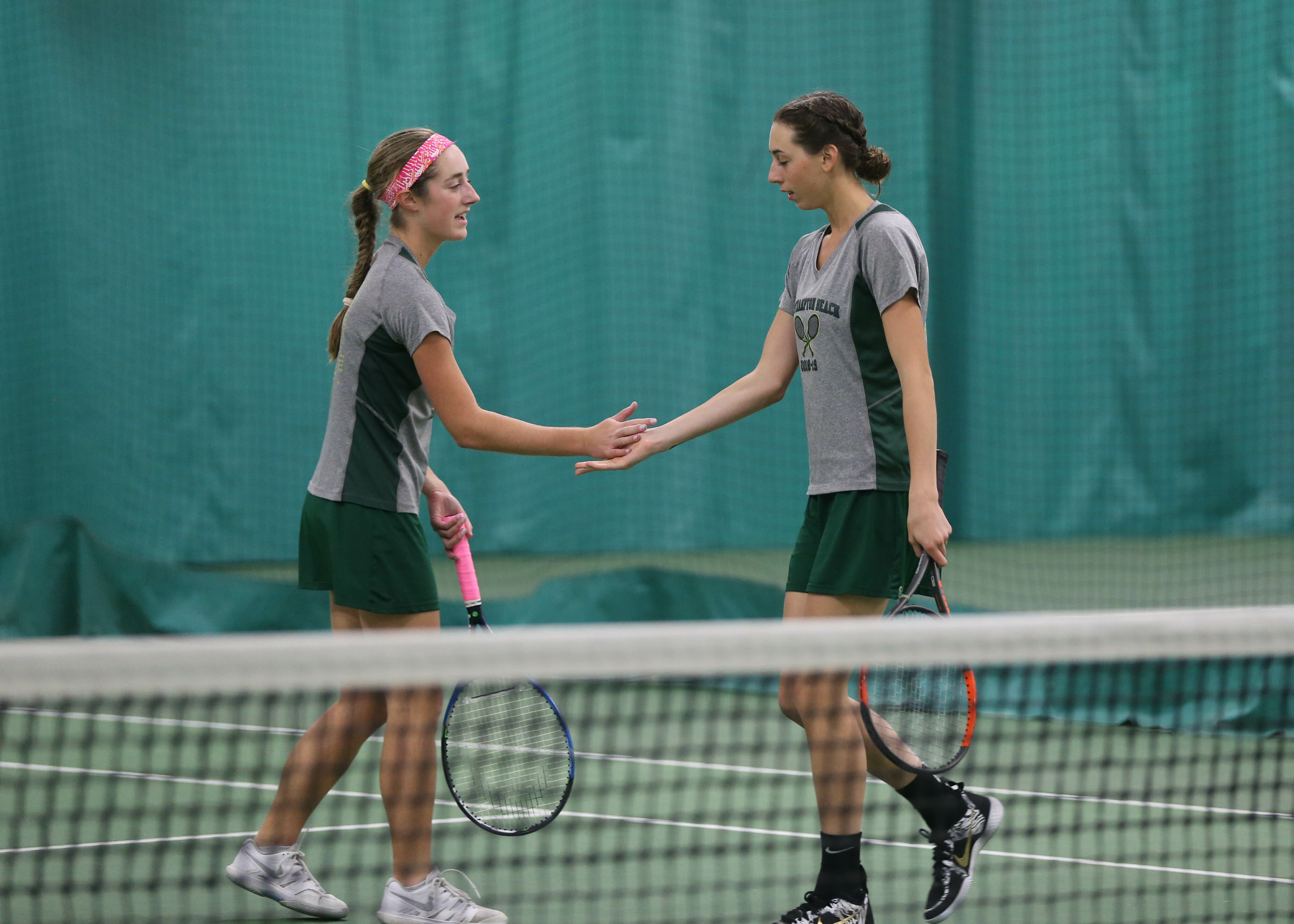 and Jen Curran congratulate each other on a point in their doubles match at states. GABE RODRIGUEZ