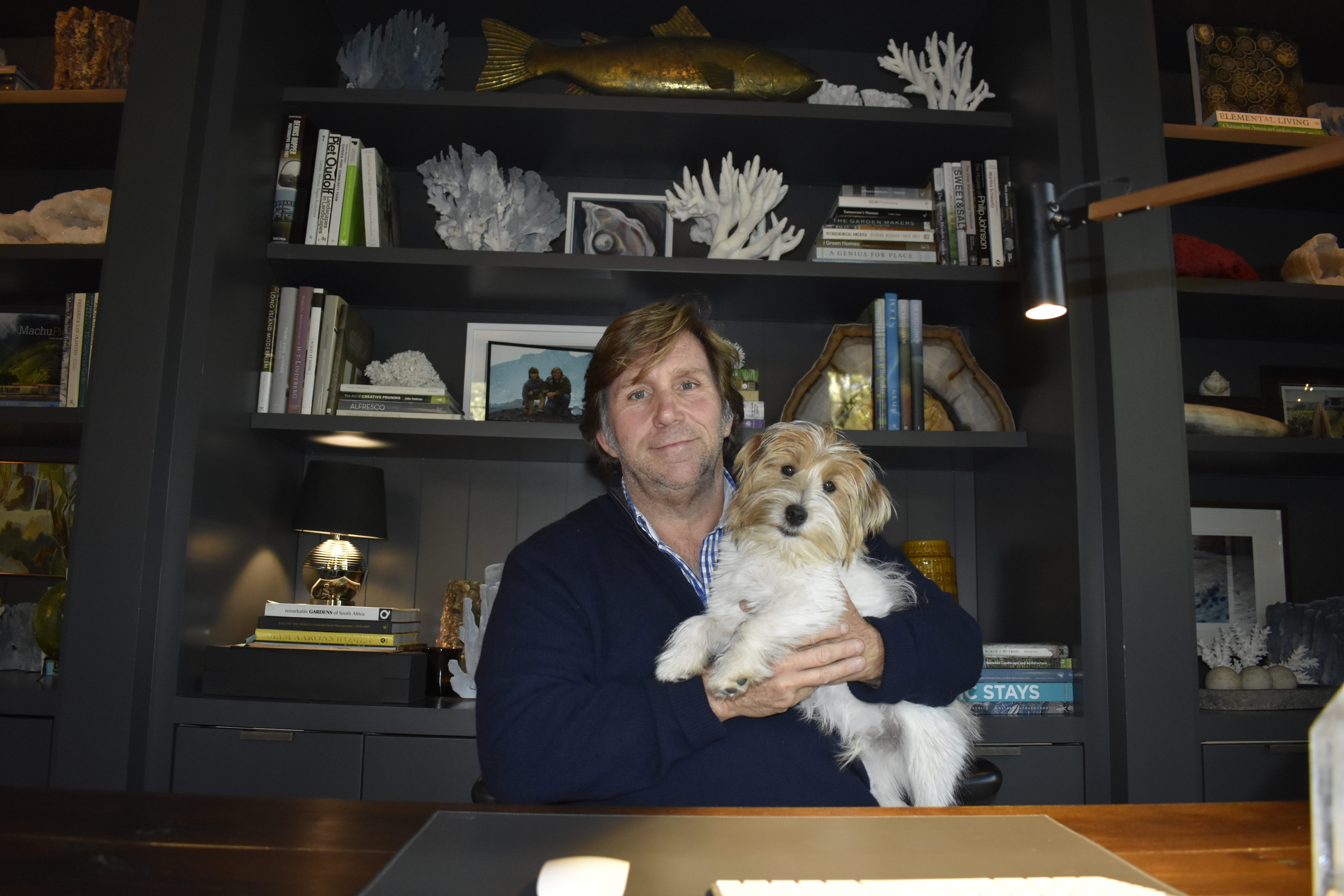 Michael Derrig and his wire-haired Jack Russell terrier Carlos in his office. BRENDAN J. O'REILLY