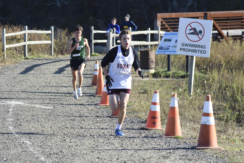 East Hampton sophomore Evan Masi heads toward the finish line.
