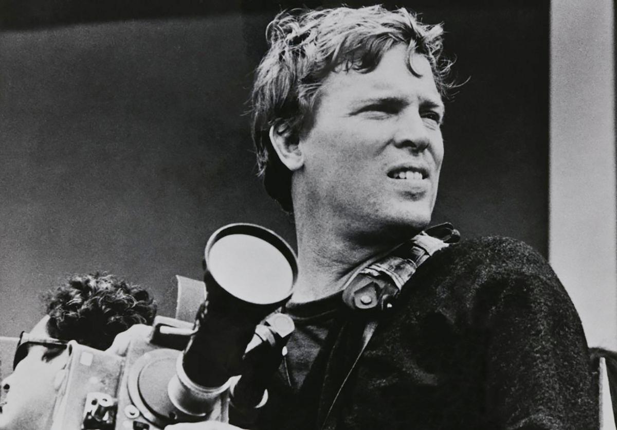 Filmmaker DA Pennebaker with an Arri Reflex movie camera.