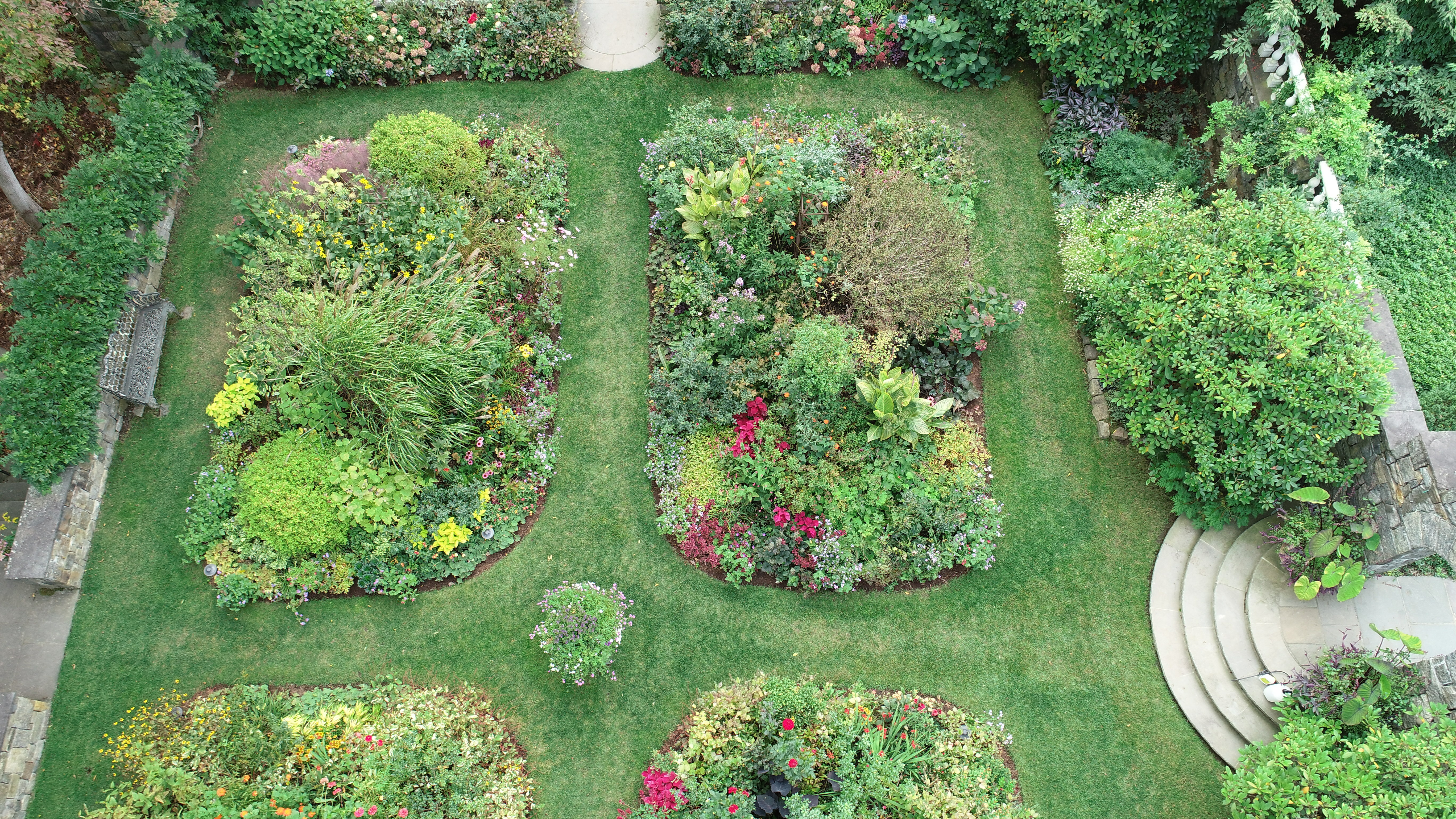 Drone views of gardens can reveal plant density as well as under or unutilized space. Can you spot areas in these gardens that might be 'opportunity' spots for next year? THG AVIATION