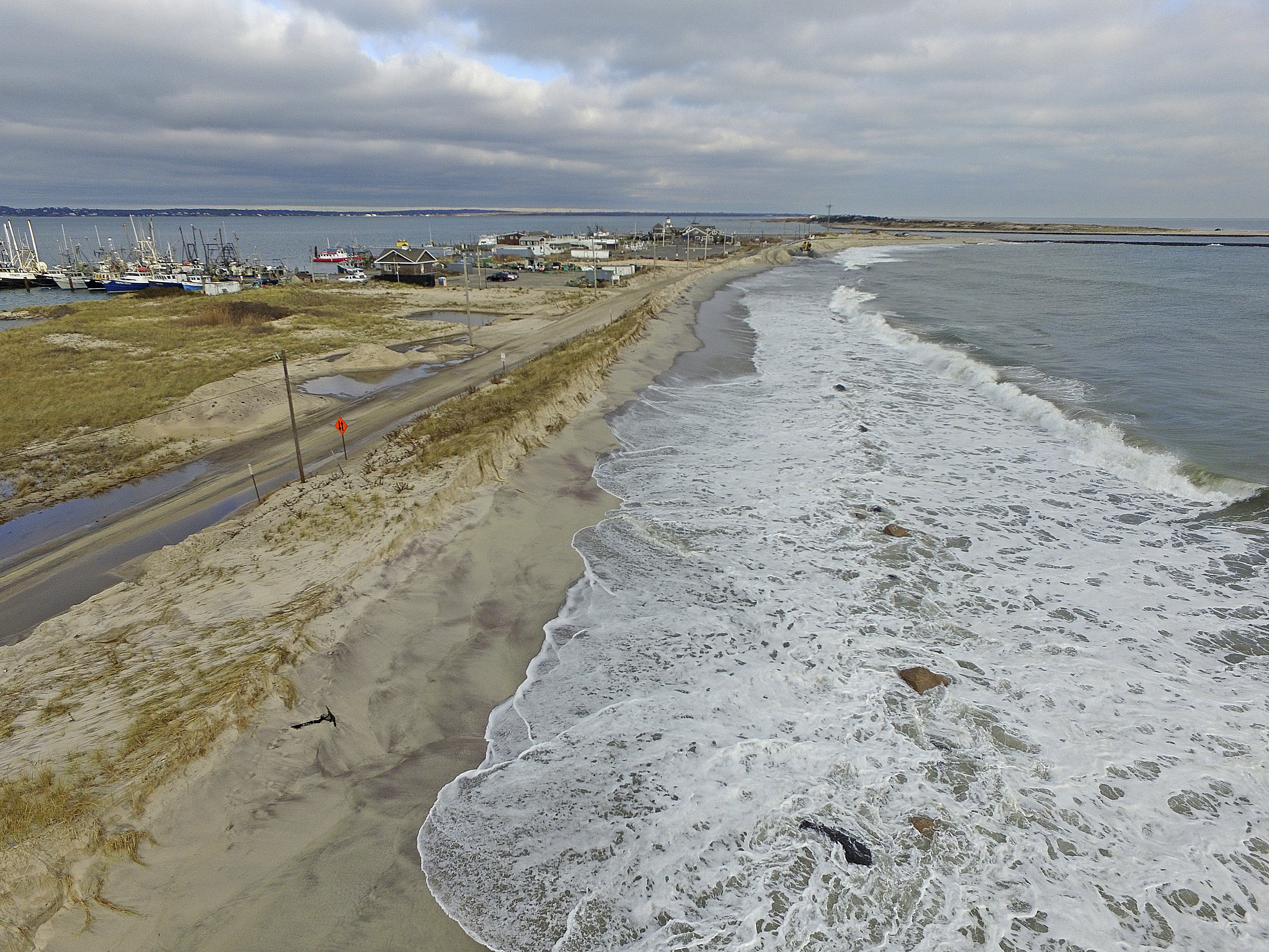 Crews work to bolster the damaged dunes on Tuesday afternoon.