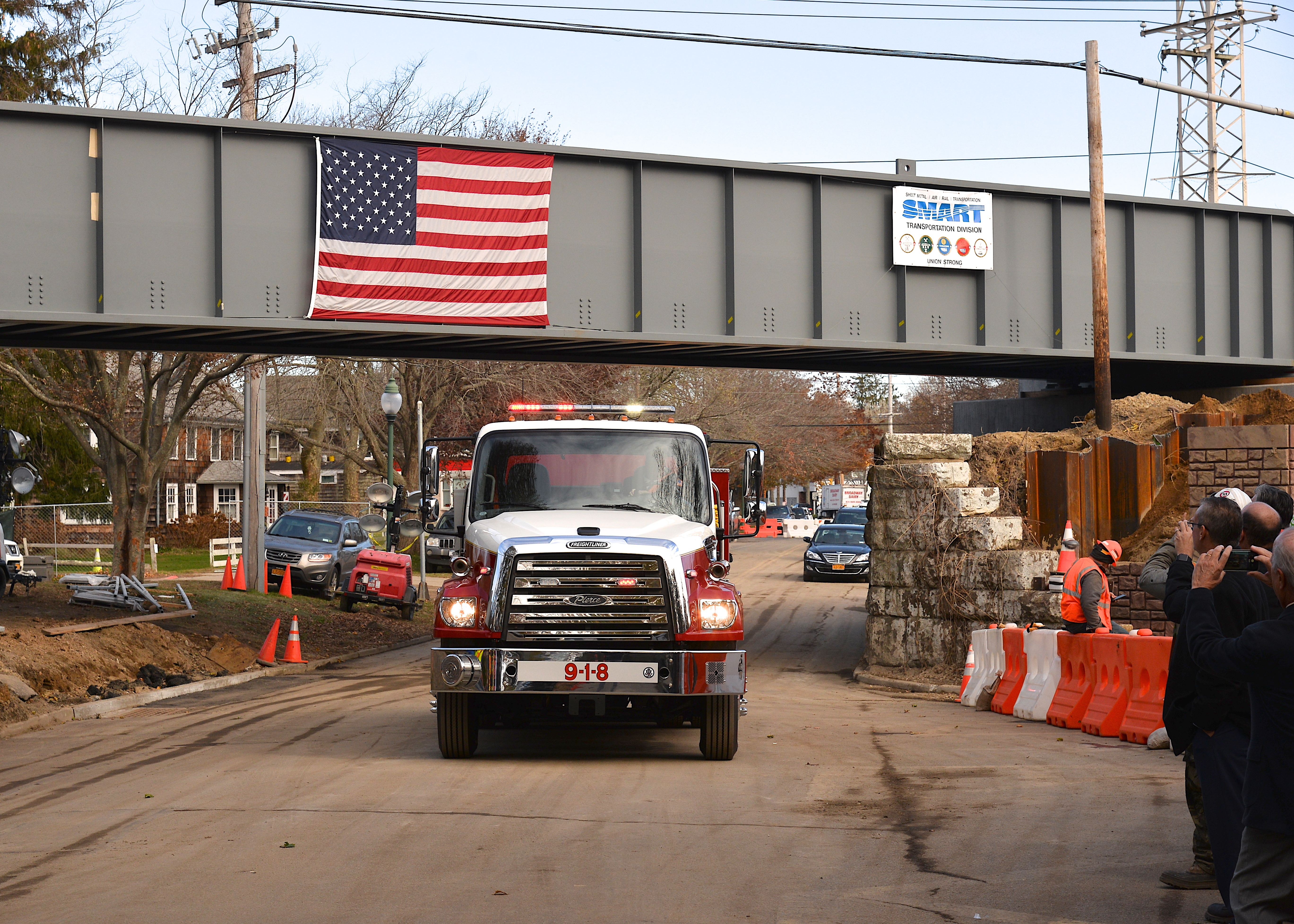 Instead of a ribbon cutting ceremony, a large fire truck was driven under the newly raised bridge.  KYRIL BROMLEY