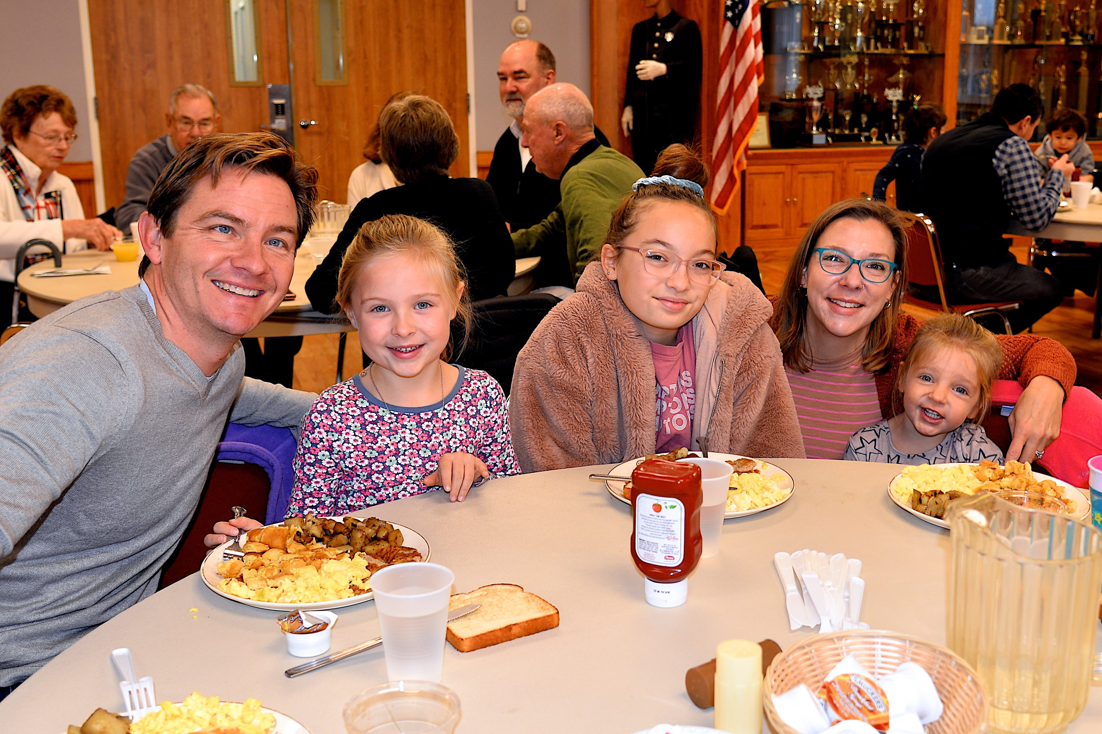 The East Hampton Fire Department hosted a pancake breakfast on Sunday, raising funds for the Eleanor Whitmore Early Childhood Center. Among those attended were members of the Feleppa family, from left, Alex, Fay, Ea, Jolie and Krissy.  KYRIL BROMLEY