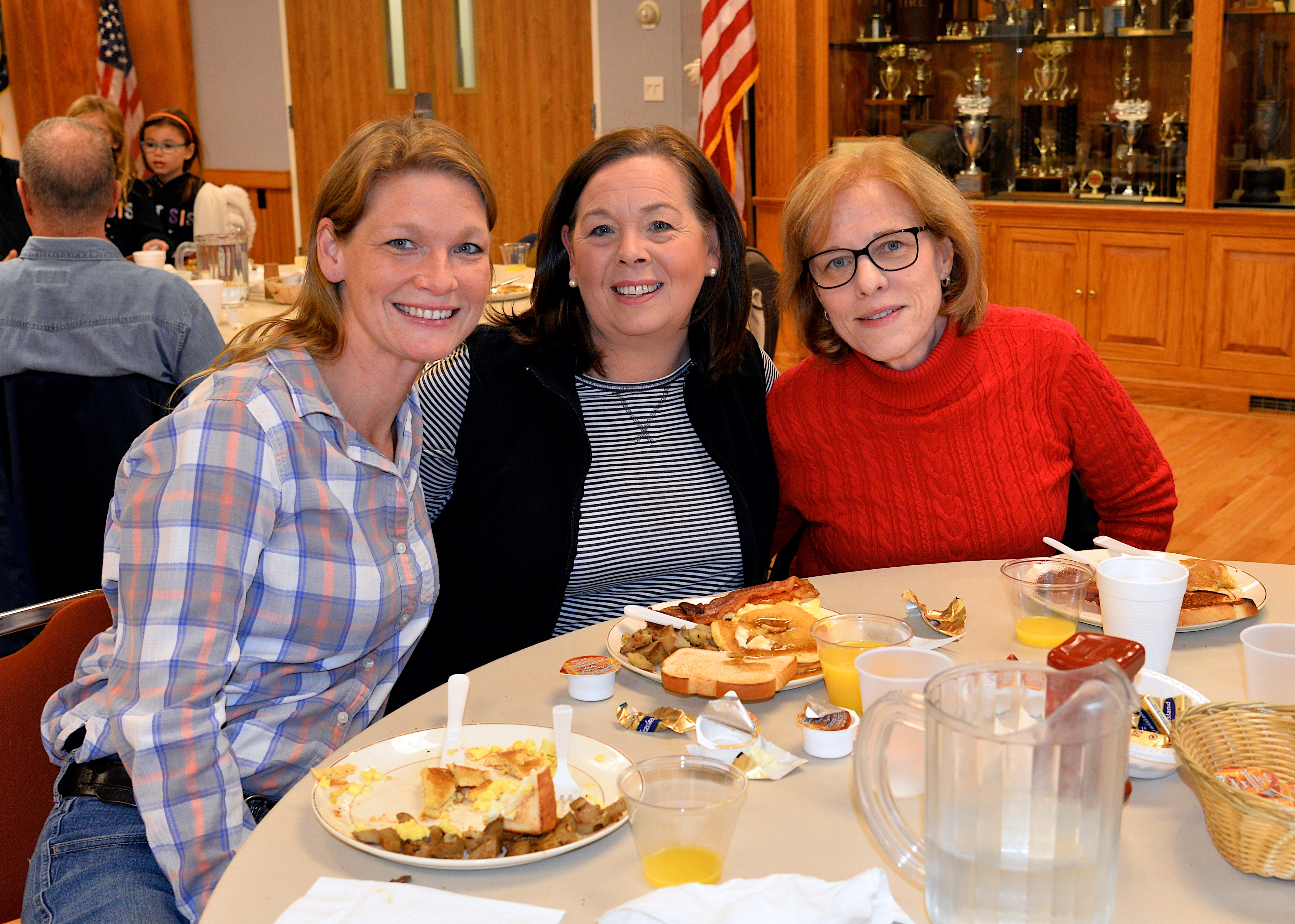 The East Hampton Fire Department hosted a pancake breakfast on Sunday, raising funds for the Eleanor Whitmore Early Childhood Center. From left, Erin Abran, Alison Anderson and Barbara Bock turned out to support the effort. KYRIL BROMLEY