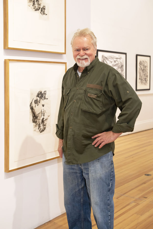 Dan Welden at the Southampton Arts Center with work from the current printmaking exhibition.
