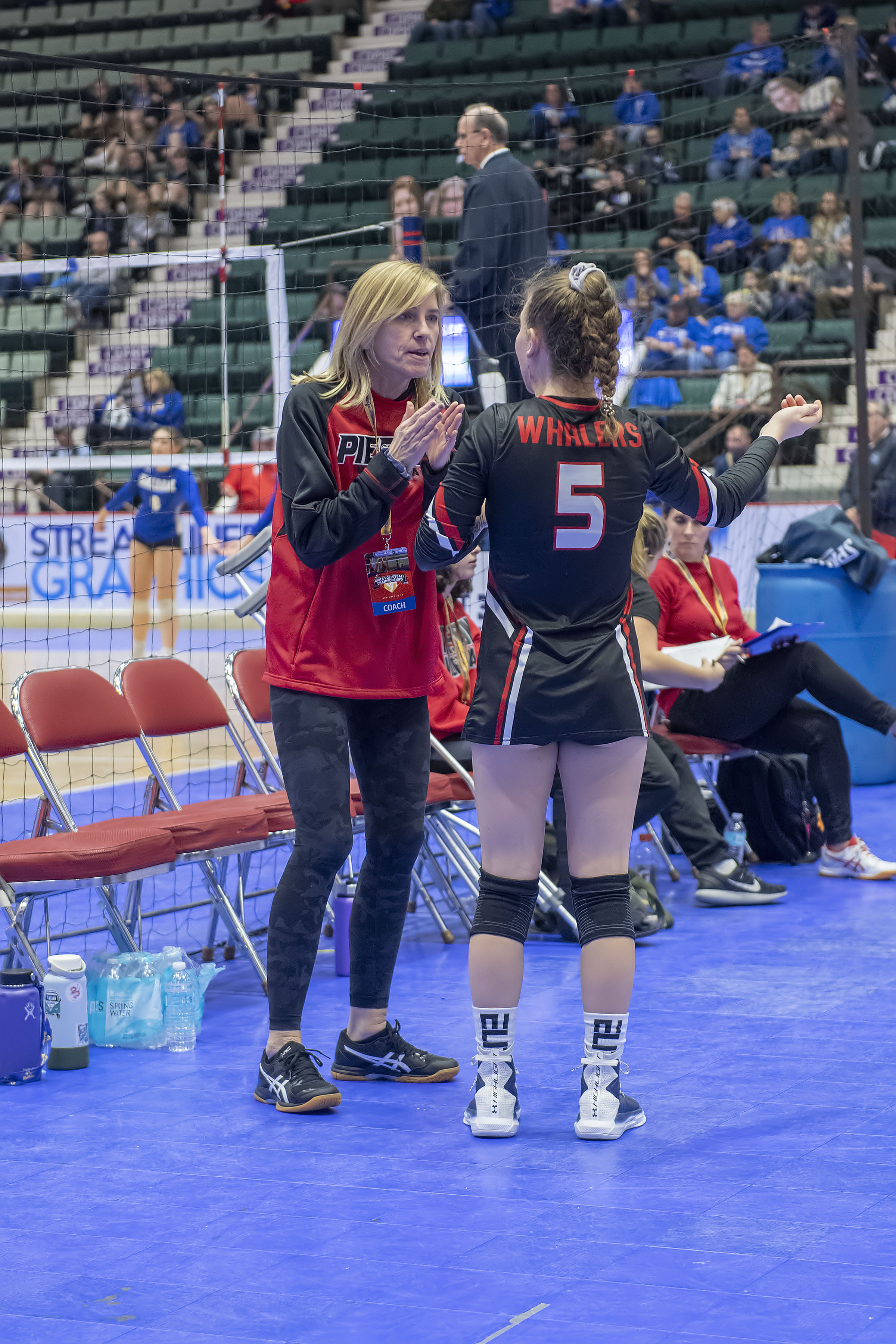 Pierson head coach Donna Fischer gives Sofia Mancino a pep talk during a timeout in the Lady Whalers' second match of the day against the Valhalla