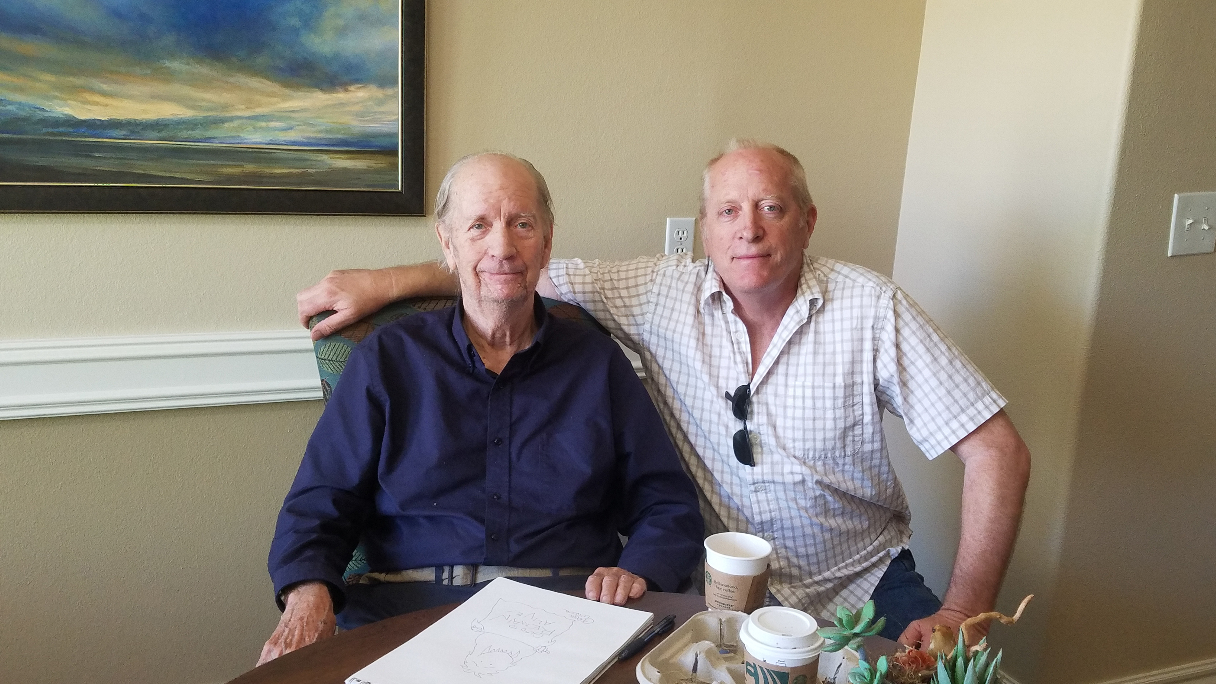 Gahan Wilson earlier this year with his stepson, Paul Winters, at the memory care facility in Arizona.