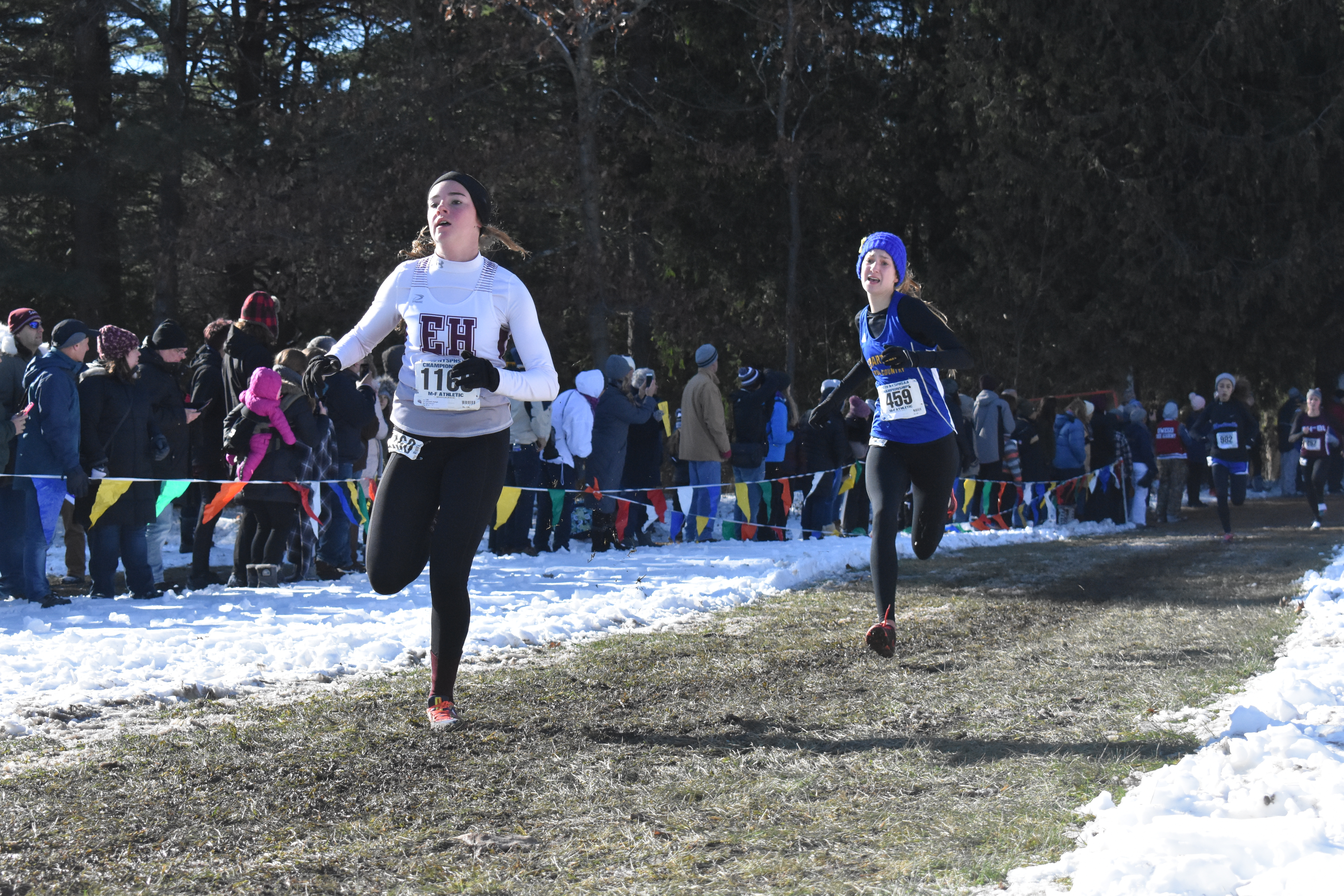 East Hampton's Ryleigh O'Donnell reaches the finish line.
