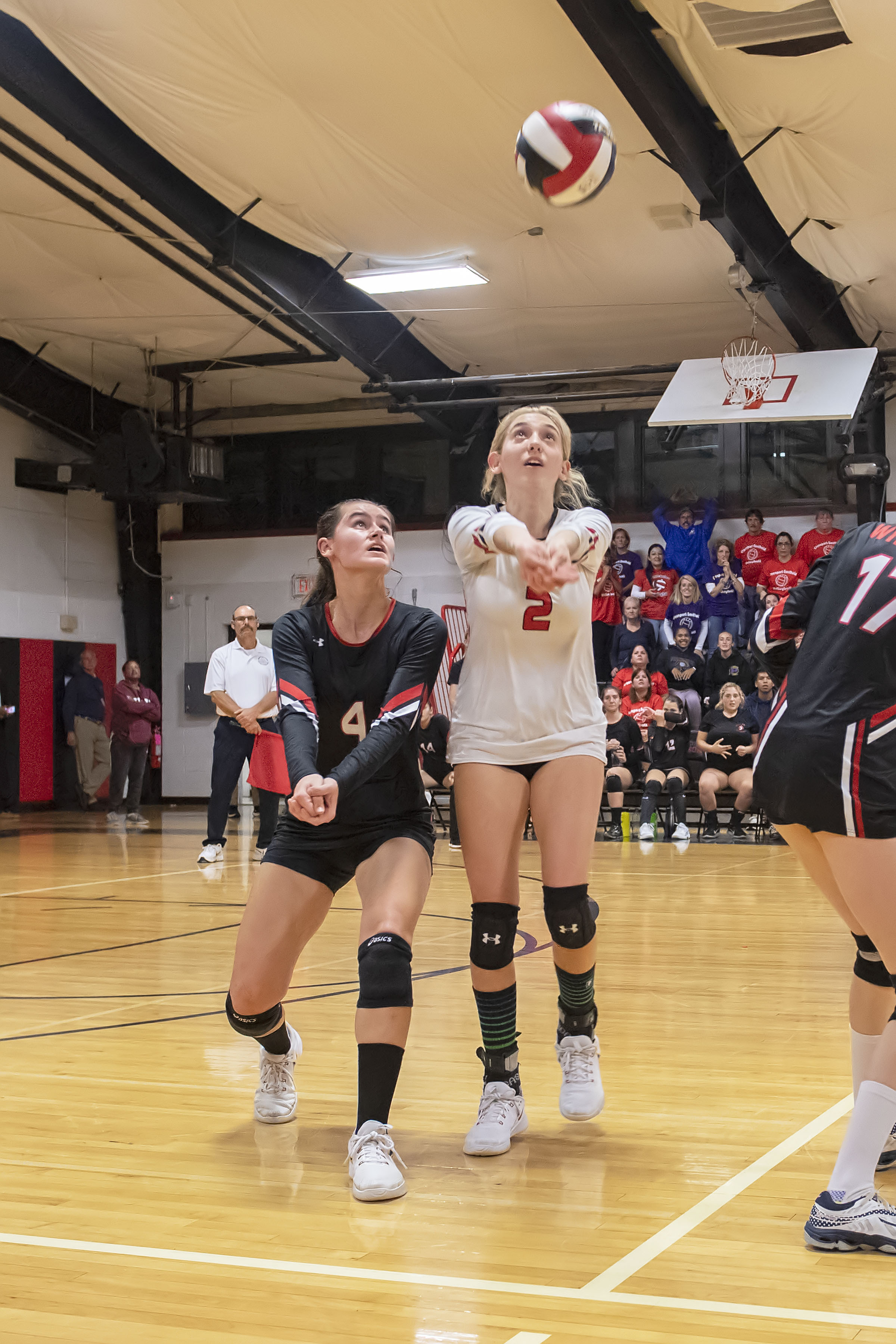 Lady Whalers Sam Cox, left, and Olivia Cassone have the ball covered.