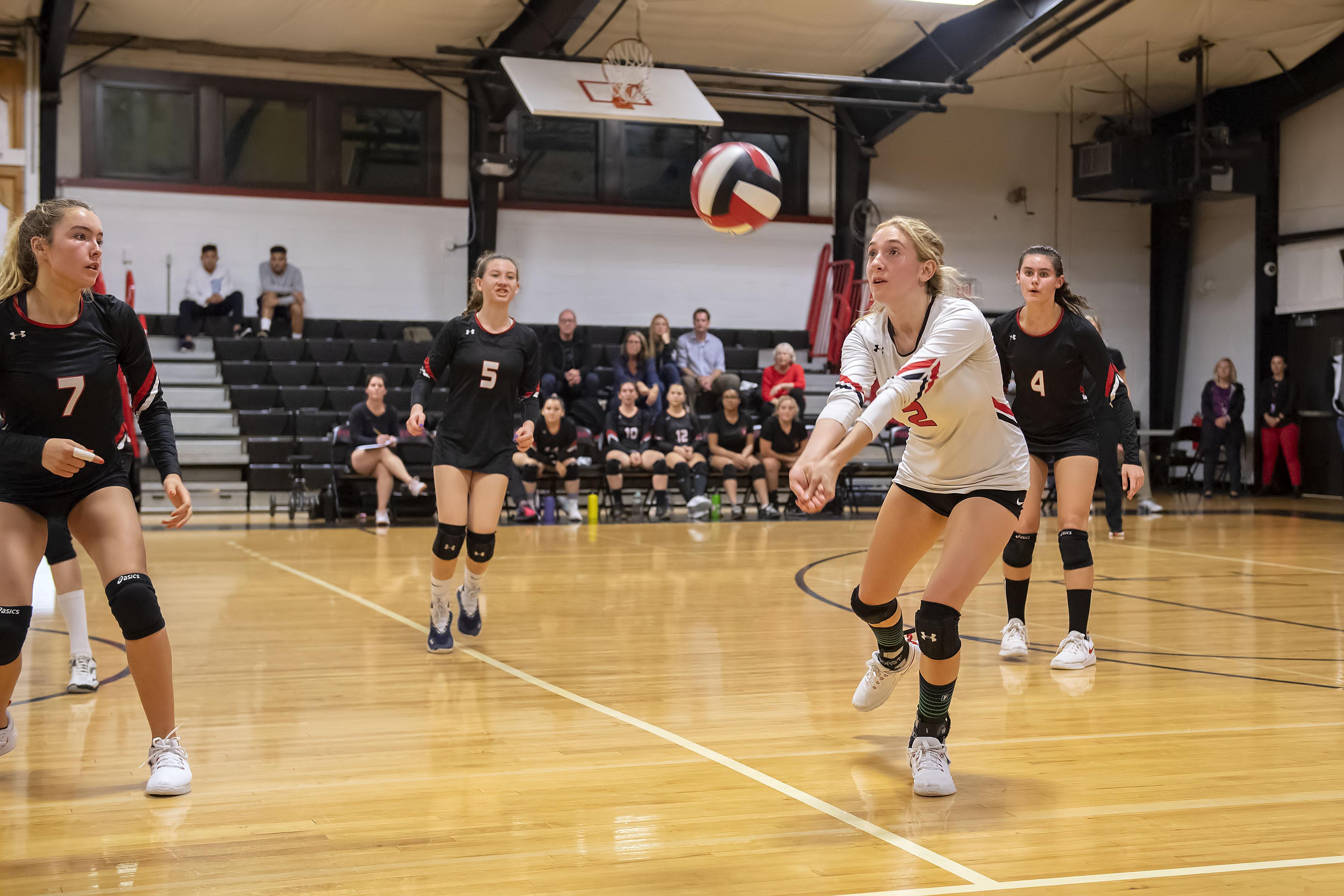 Pierson senior Olivia Cassone gets to a ball.