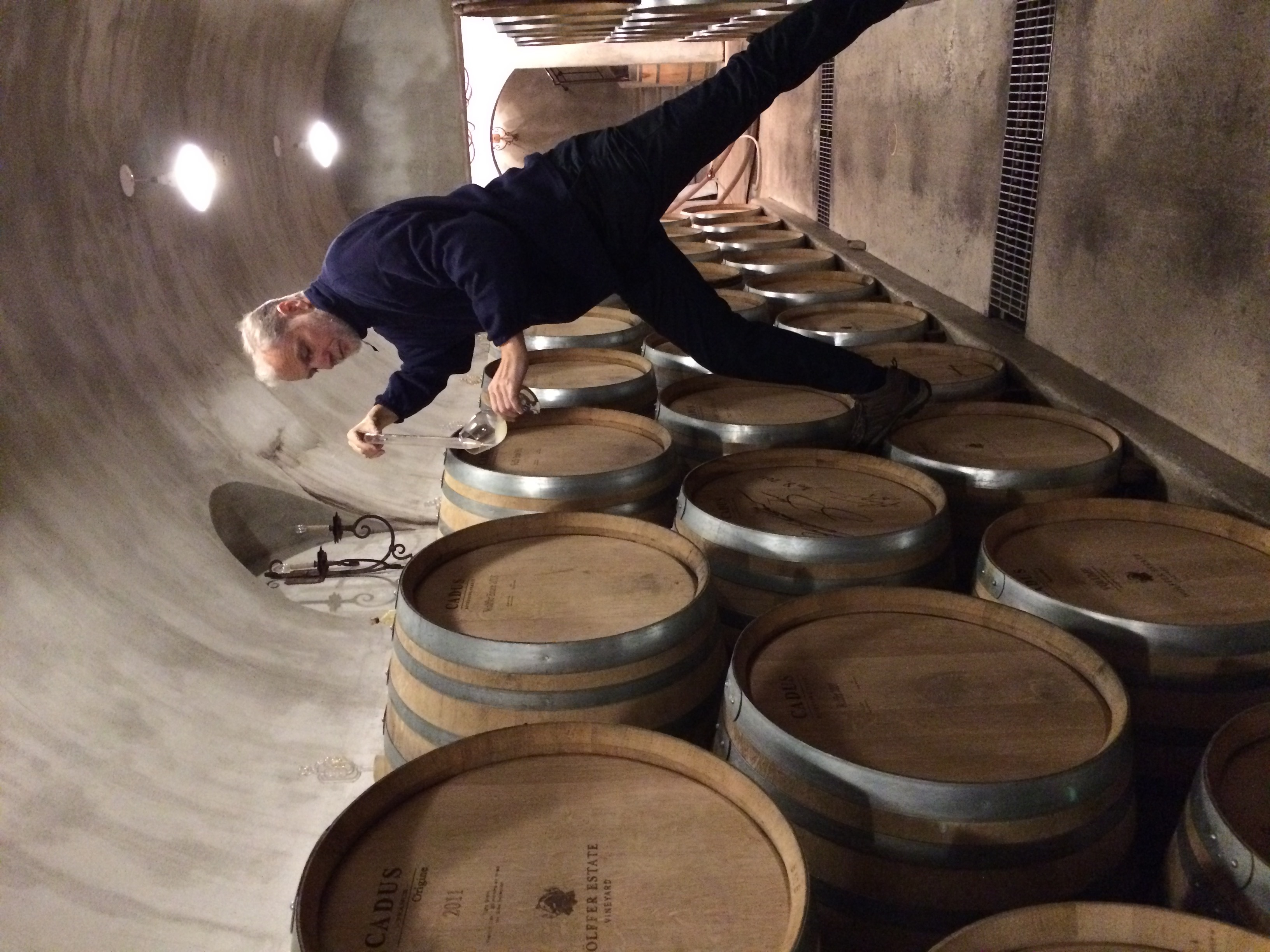 Roman Roth sampling from the barrels at Wolffer Estate Vineyard.
