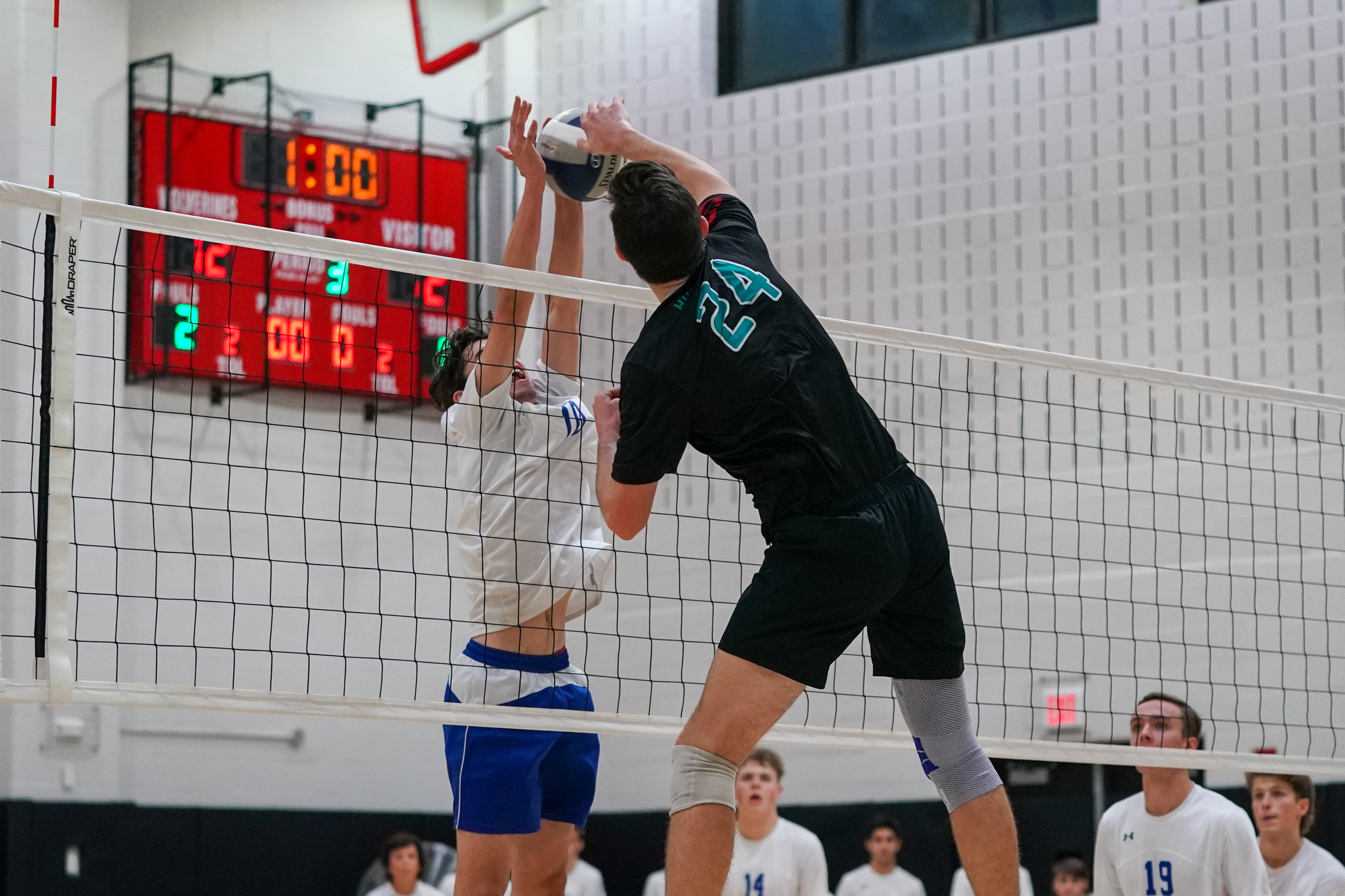 Westhampton Beach junior Ryan Barnett slams down a kill.