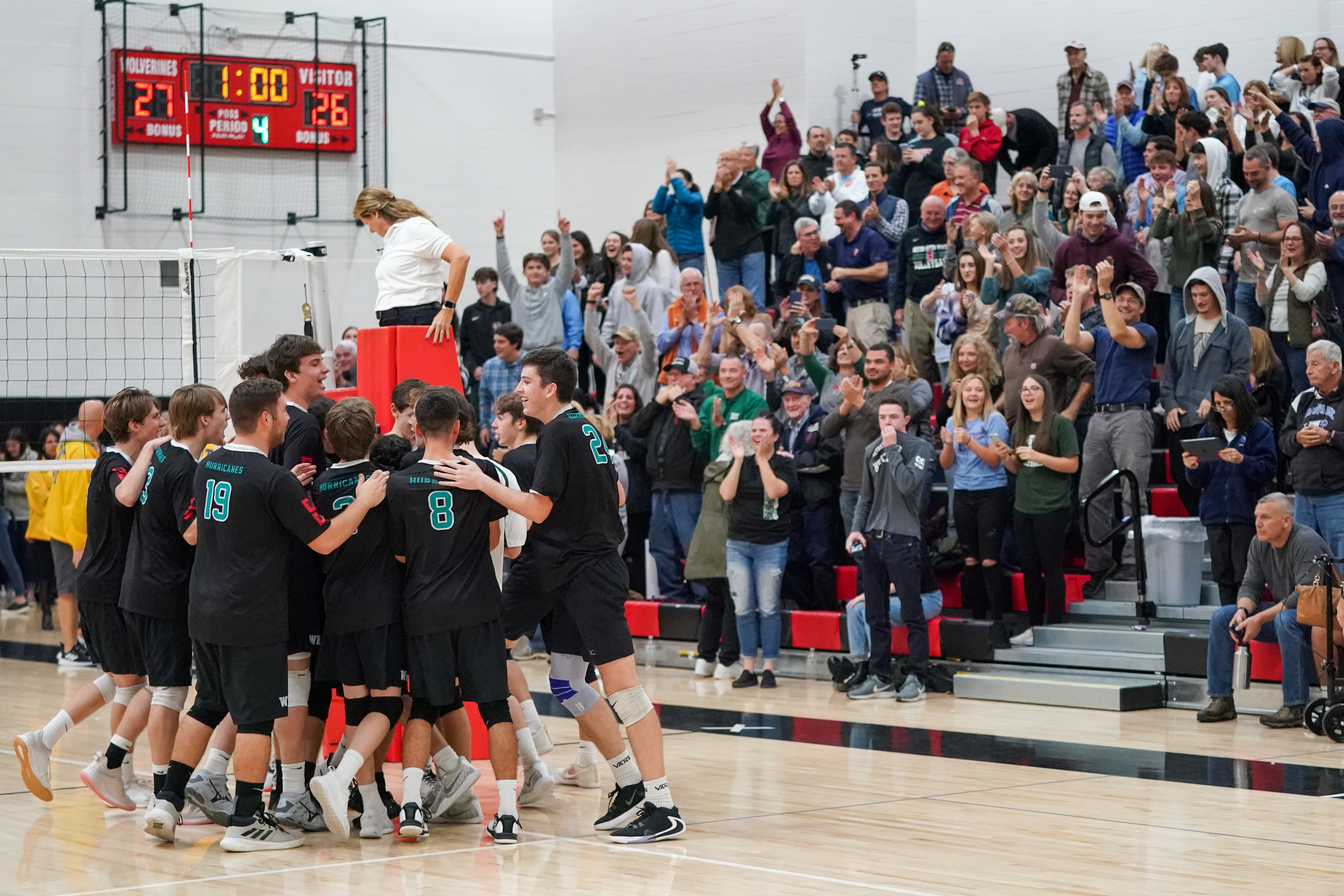 The Hurricanes celebrate their first ever county title while their crowd cheers them on.