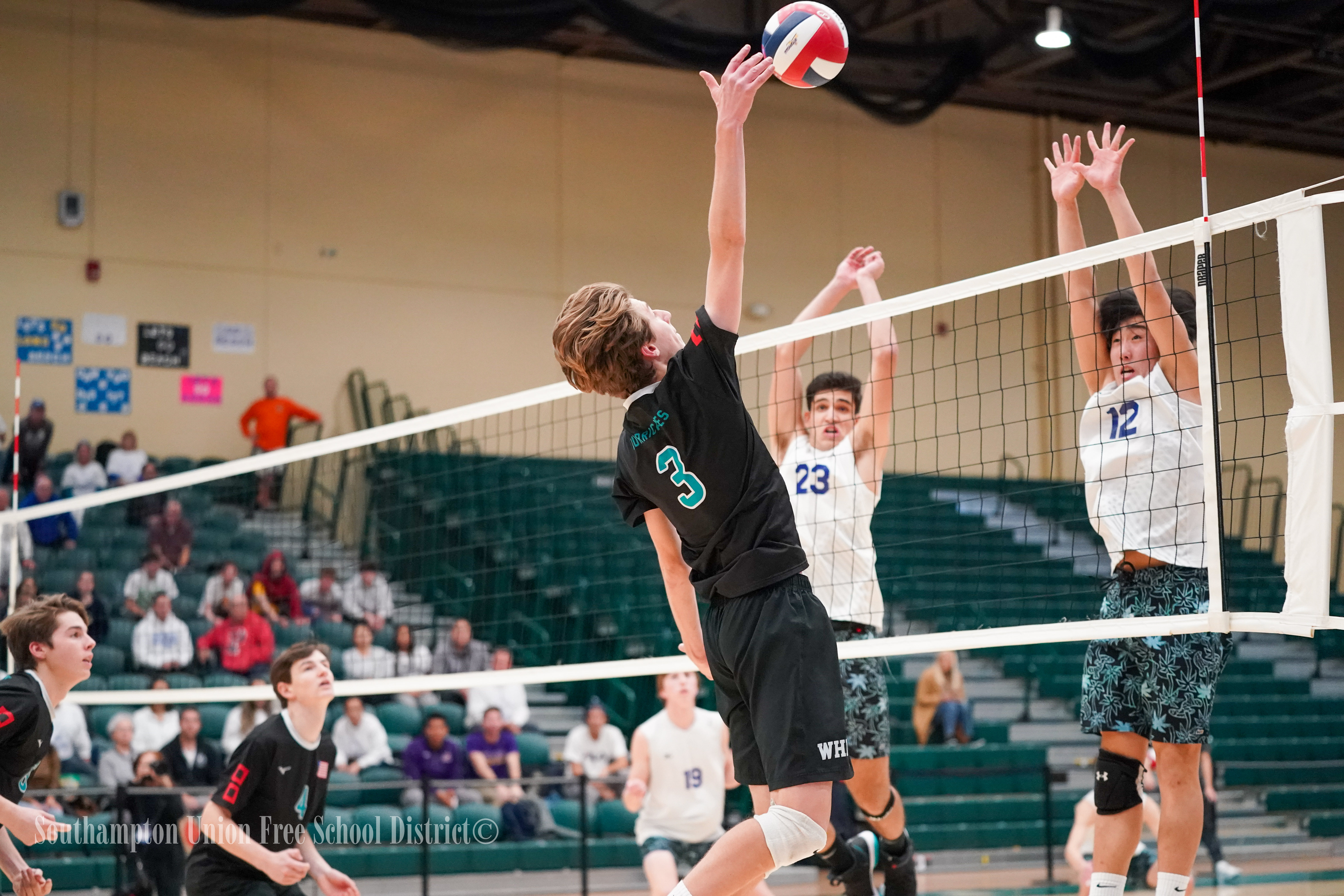Westhampton Beach junior Hank Scherer sends the ball over the net.