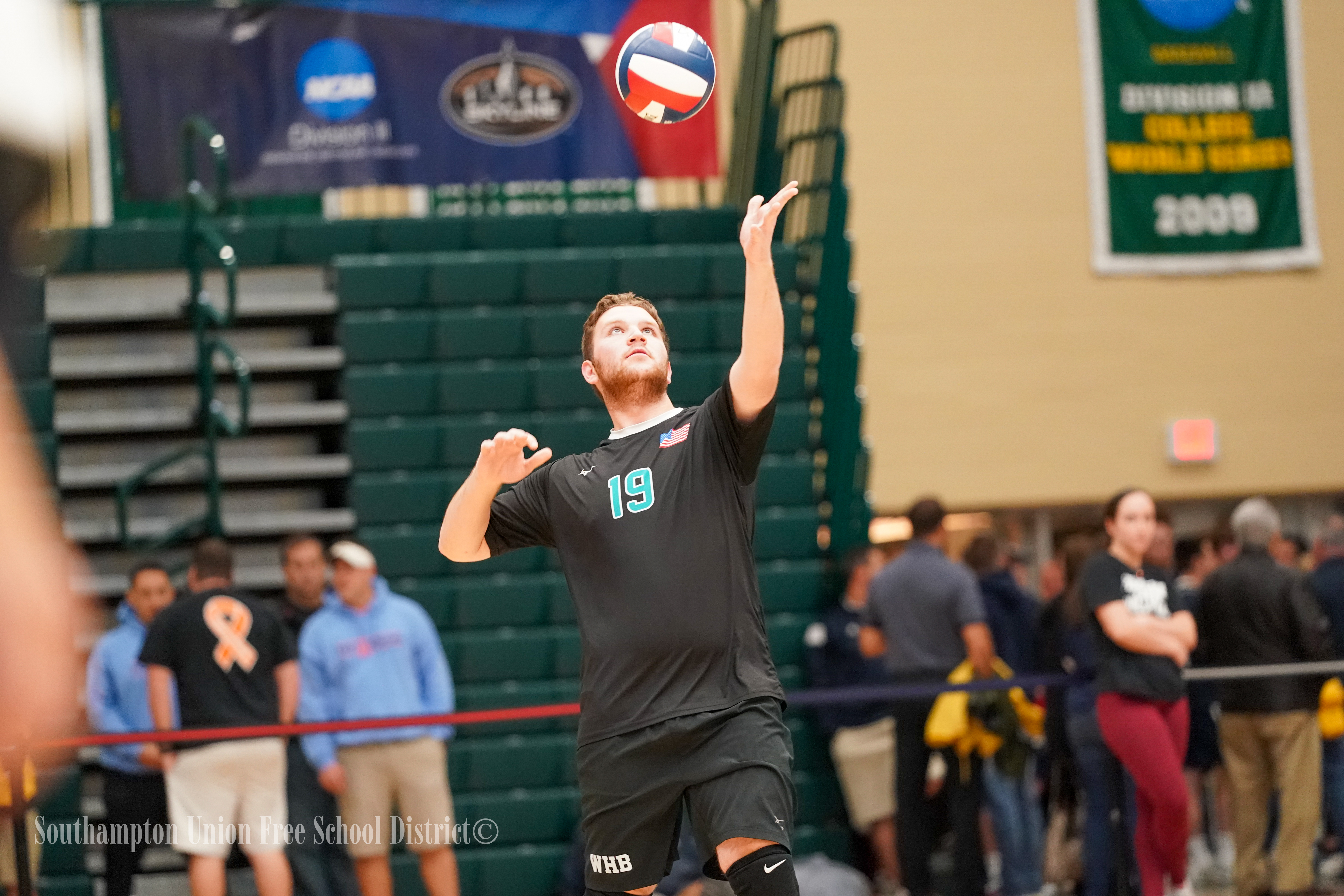 Westhampton Beach senior Donovan Kerns serves the ball.