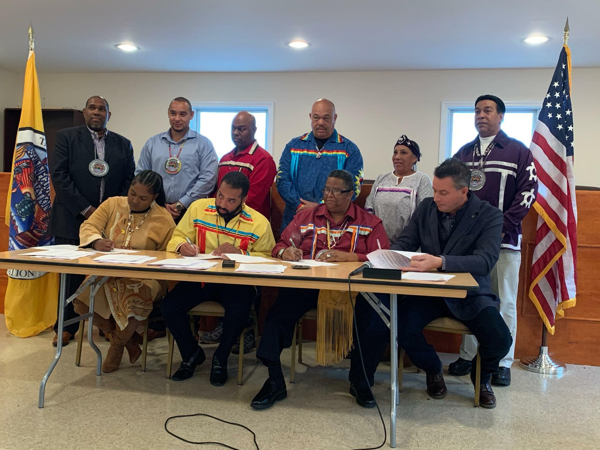 Barre Hamp, Seneca Bowen, Germain Smith, Daniel Collins Sr., Linda Franklin, Lance Gumbs, Chenea Bullock, Bryan Polite, Donald Williams, Jr., Todd J. Bergeron at the signing ceremony.