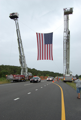 The motorcade drives down County Road 39 in Southampton