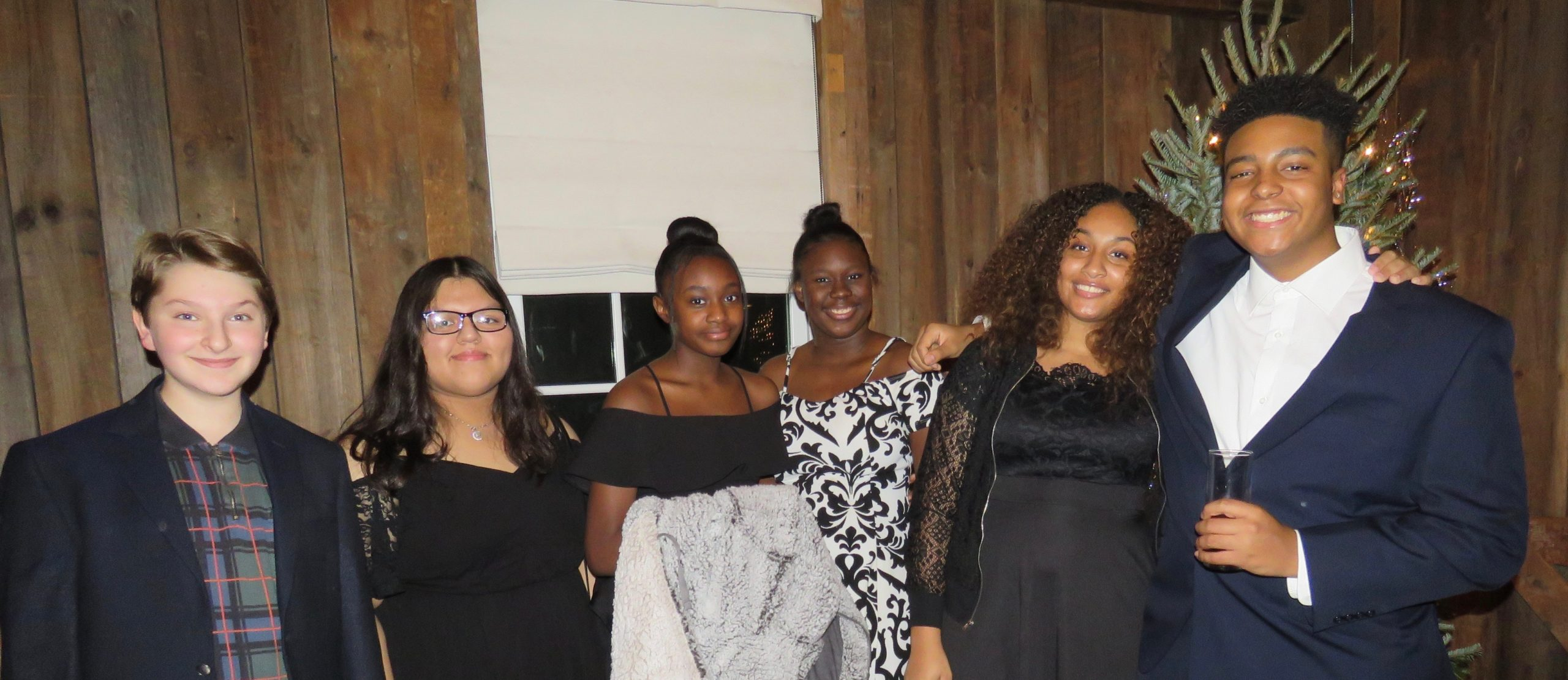 The Bridgehampton Childcare and Recreational Center held its annual holiday fundraising dinner at the Topping Rose House in Bridgehampton on December 15.  Among those attending were Sivia Loria and Bonnie Michelle Cannon, right, and a group of supportive teens.