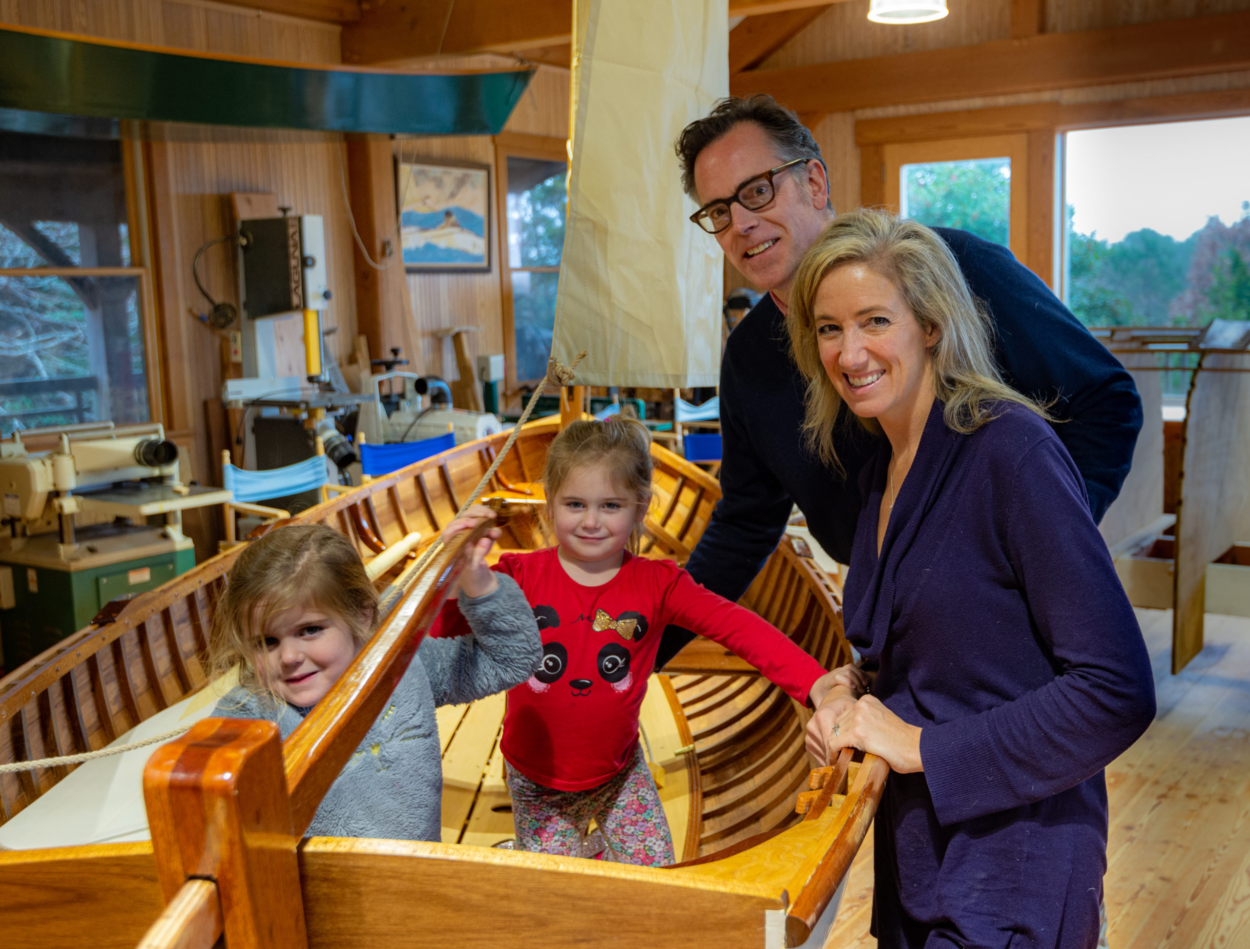 Colleen DeBaise with her husband, Frank Guittard, and twin 4-year-old daughters, Allie and Georgie. Ms. DeBaise was the winner of the 2019 East End Classic Boat Society's raffle boat, a 12-foot Catspaw sailing dinghy. HUGH BROWN