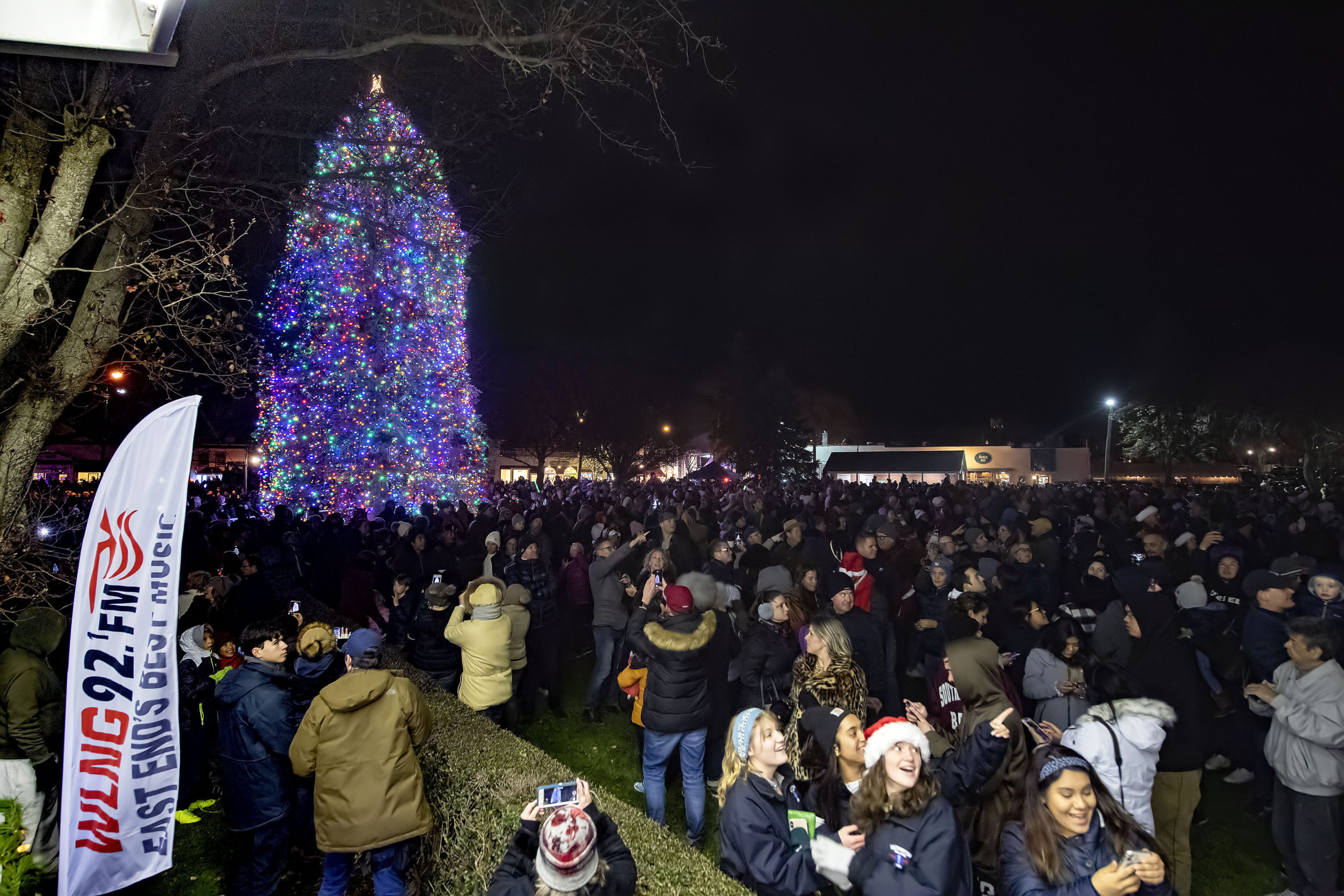 Thed crowd reacts as the fireworks begin during the Christmas Tree-Lighting Ceremony and Fireworks in Agawam Park following the 2019