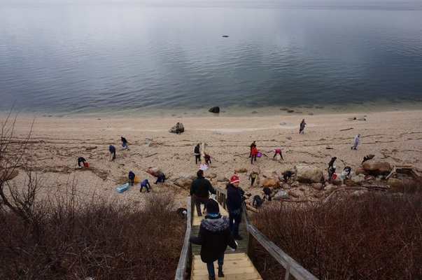 Volunteers pick up debris on 67 Steps Beach in Greenport. COURTESY ELI SURFRIDER FOUNDATION