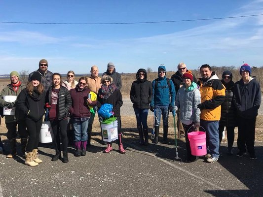 23 volunteers came out to clean up the Ponquogue Beach on Saturday. COURTESY ELI SURFRIDER FOUNDATION