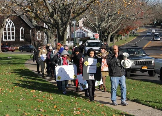leads protesters through East Hampton Village on Saturday to demand an end to the village's deer sterilization program. KYRIL BROMLEY
