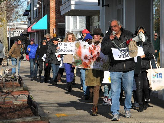 Protesters marched in East Hampton Village on Saturday afternoon demanding an end to the village's deer sterilization program. KYRIL BROMLEY