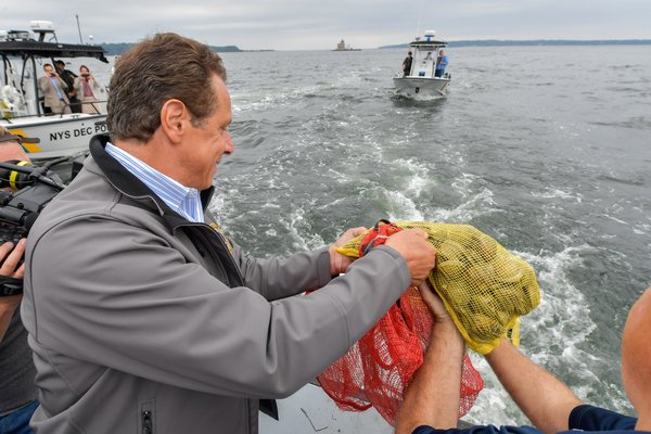 Governor Andrew Cuomo announced a $10.4 million plan to improve water quality on Long Island that will create a shellfish sanctuary in Shinnecock Bay. COURTESY OF ANDREW CUOMO'S PRESS OFFICE