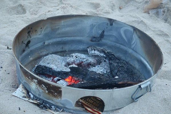 A fire is left burning from a beach party took place over the holiday weekend on a beach in East Hampton Village. FACEBOOK