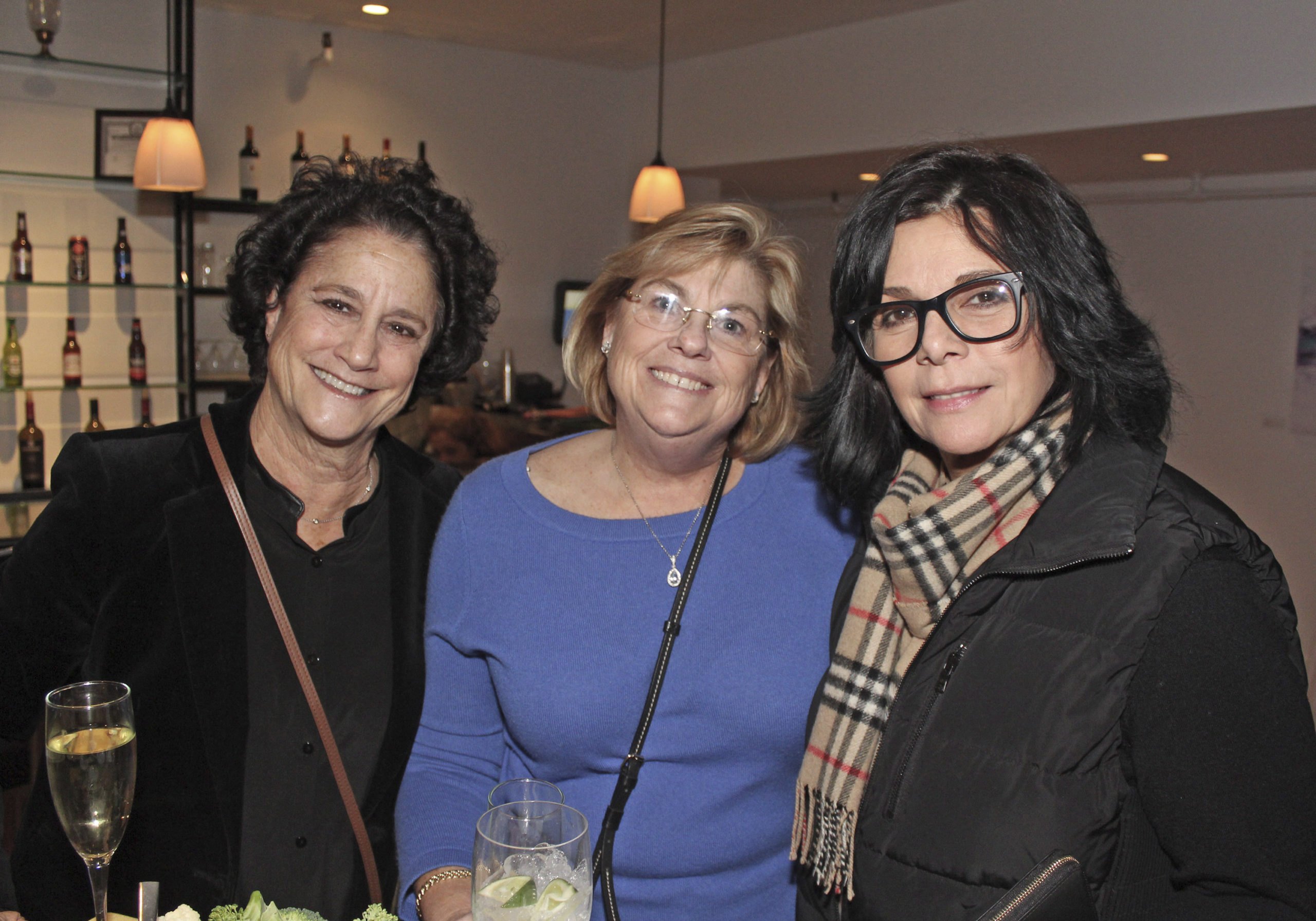 Elise Douglas, Sandy Griffin and Diane Vitale at the Maureen's Haven Homeless Outreach winter benefit on Saturday night at Seasons of Southampton. TOM KOCHIE