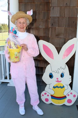 Barbara Albrecht greets the childrent at the North Sea Community Association Easter egg hunt.