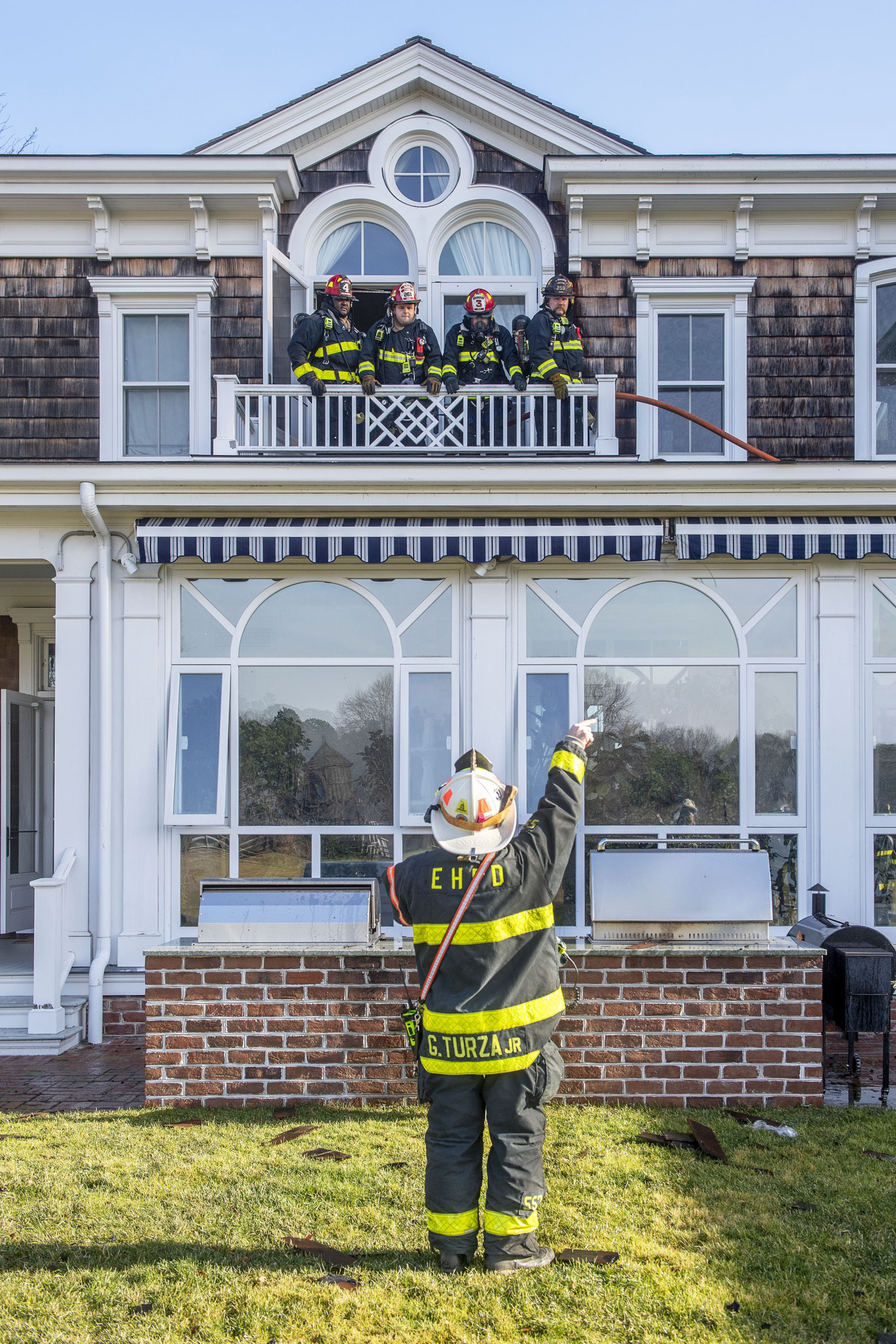 The Bridgehampton Fire Department, assisted by mutual aid from several other local fire departments, battled a   fire in the roof of a Water Mill mansion on Little Noyac Path in Water Mil on Saturday.