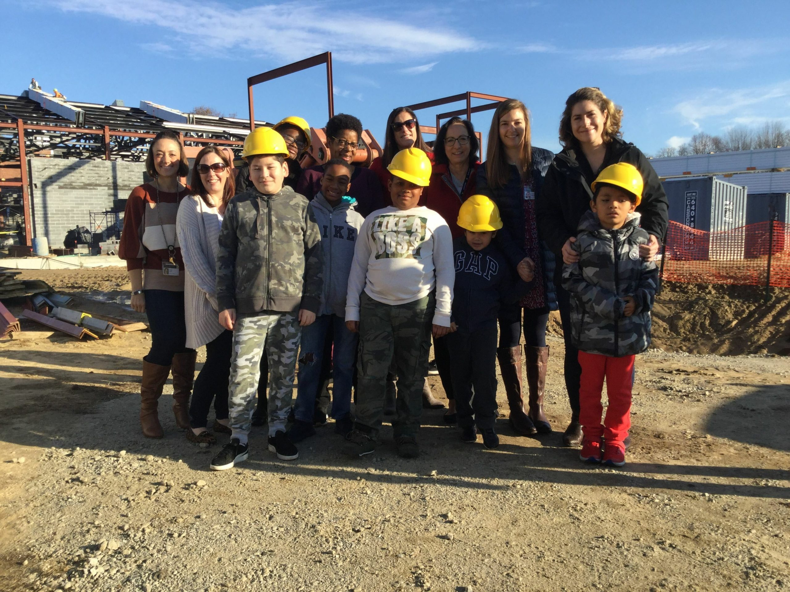 Dr. Angela Austin, Bridgehampton School District director of pupil personnel services and ENL, left, with staff and students of the Construction Student Ambassador Program.