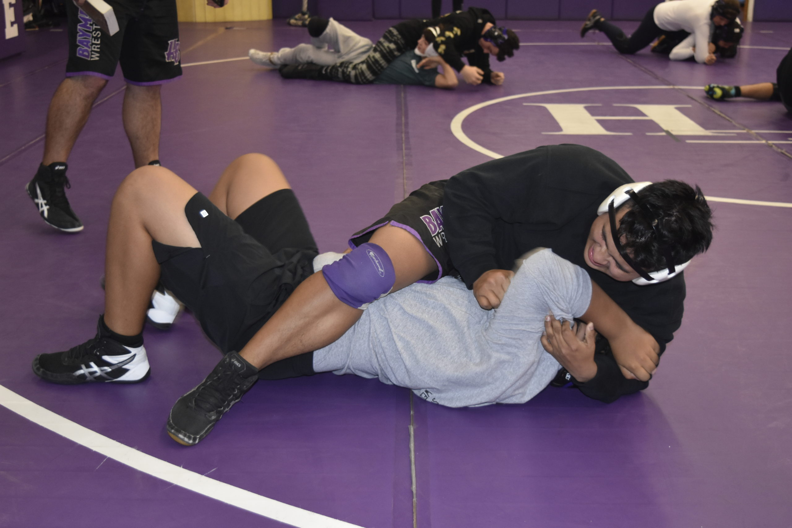 Alex Velasquez works with a teammate during a Saturday morning practice.