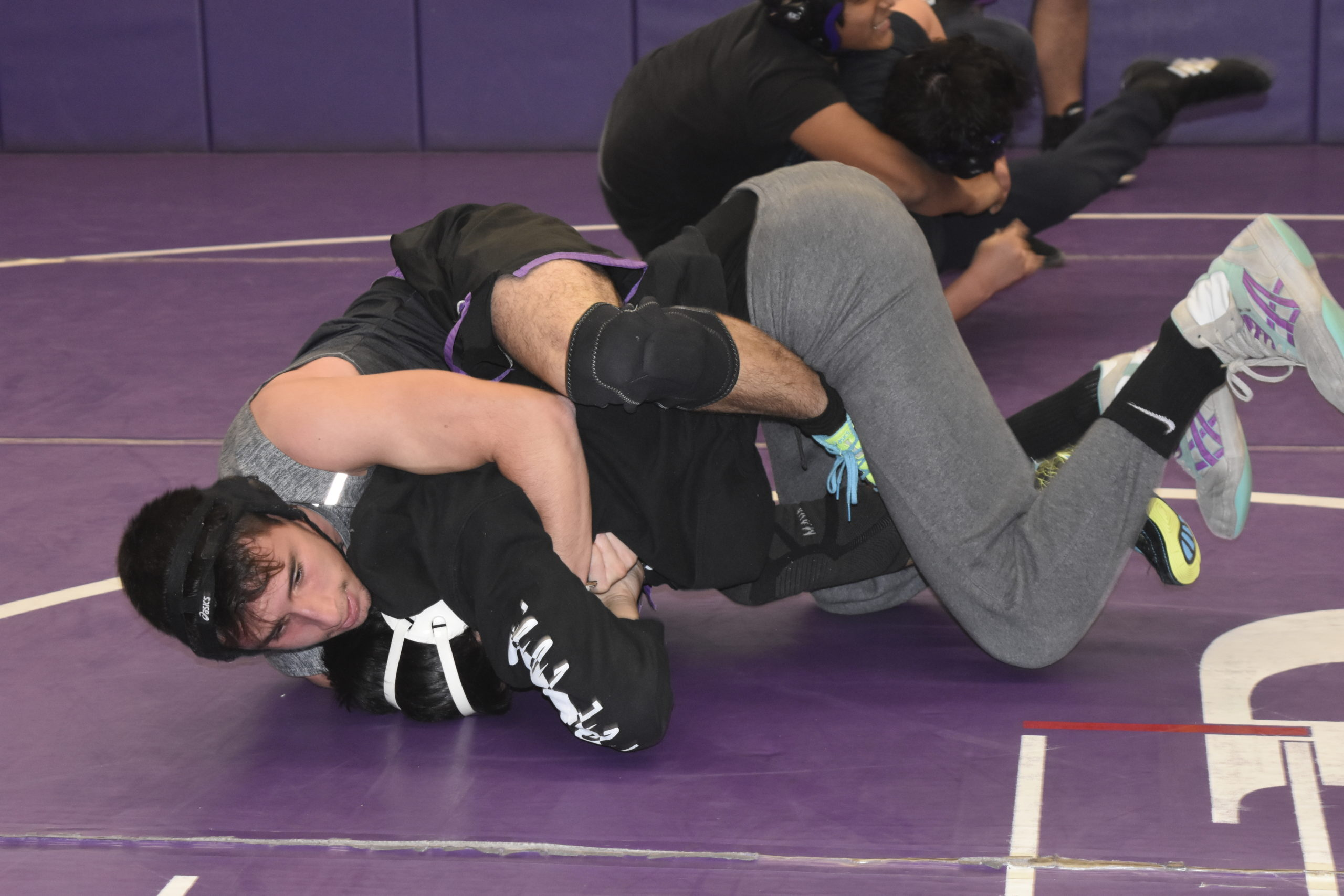 Nick Pacheco works with a teammate during a Saturday morning practice.