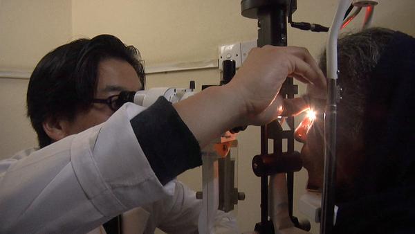 Dr. Teng post-examination of