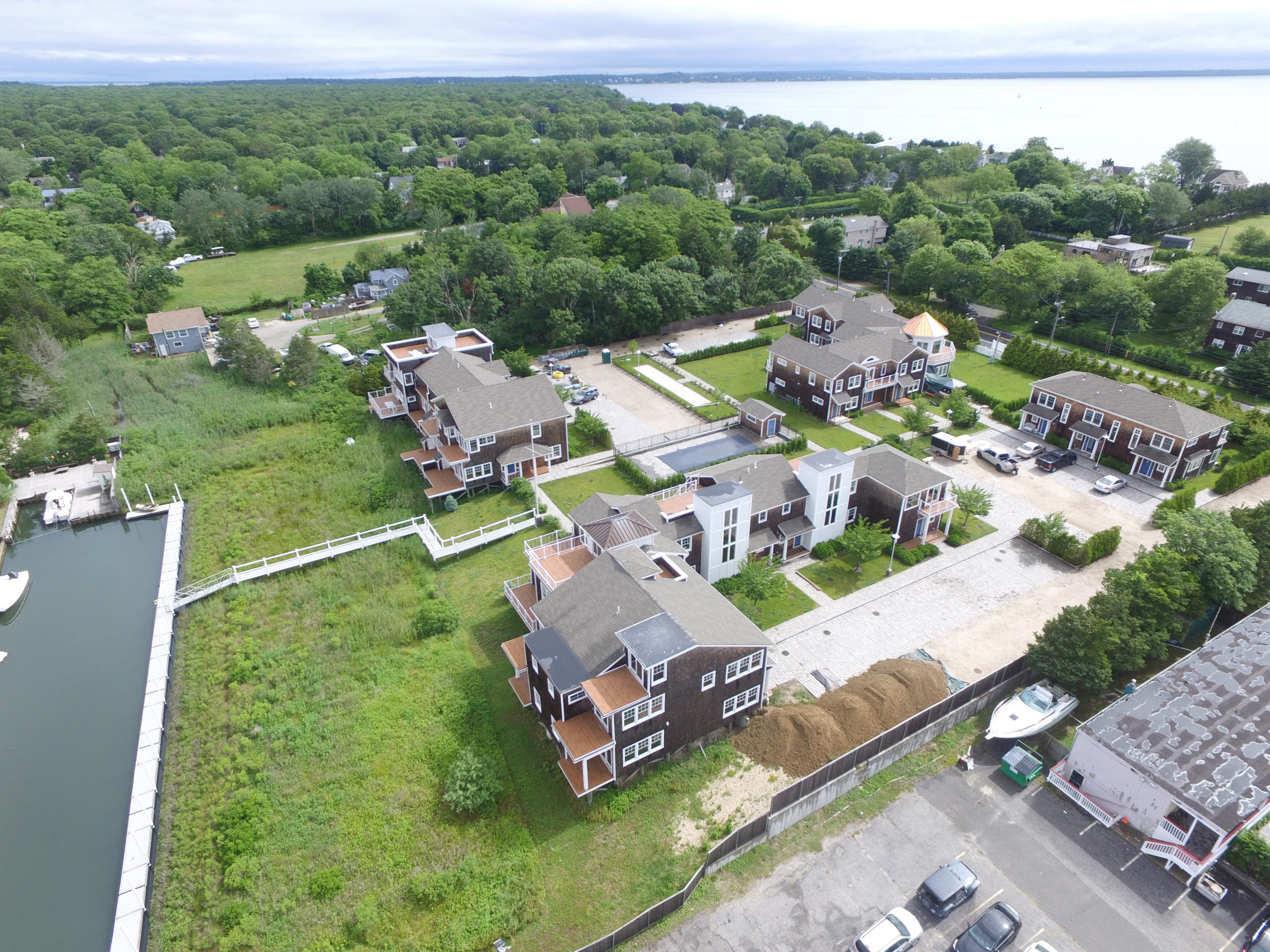 August 30 -- A court has ordered the sale of Ponquogue Point, the bankrupt condominium project on Foster Avenue in Hampton Bays that stalled when it was near completion. Ponquogue Point has sat mostly idle for a few years as the project has been caught up in legal battles. But now, with the court-ordered bankruptcy sale, a new owner could soon step in to finish the development, and residents could start moving in shortly thereafter. Meridian InvestmentSales, a New York City real estate firm, is marketing Ponquogue Point after the court approved the firm in a July 23 order.