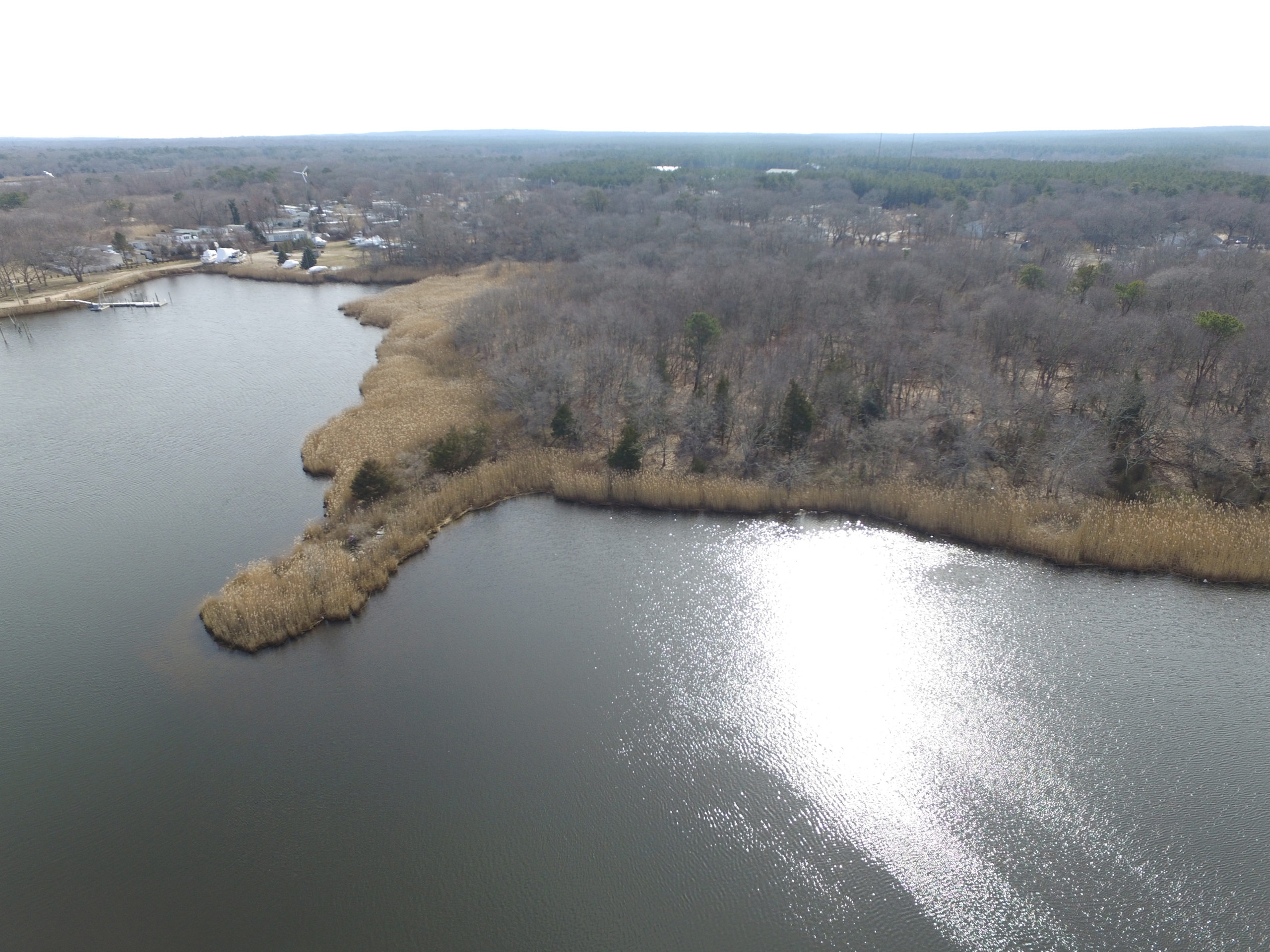 "February 28 -- A developer's plans for her shrinking Riverside property remain in limbo, as they have for nearly 20 years, though, this time, much of that uncertainty can be attributed to the still-unrealized potential in Southampton Town's most economically distressed hamlet. Dede Gotthelf, who now owns 6.22 acres overlooking the Peconic Riverroughly one-quarter of what she had owned when she began investing in Riverside in the late 1990s—says the planned construction of a sewage treatment plant in the town's nearby Enterprise Zone could open her remaining land, as well as neighboring properties, to new possibilities. She said those options could potentially include the construction of dozens of new units of much-needed workforce housing in the municipality, or the addition of several new waterfront businesses, possibly restaurants that would overlook the water and sit across from Riverhead Town's bustling downtown. ""I think it is a phenomenal piece of property in the overall attempt to revitalize Riverside, and I think something wonderful should happen with it,"" said Ms. Gotthelf, who currently has no formal application in the works. Diana Weir, the town's director of Housing and Community Development, said she has had several conversations with Ms. Gotthelf regarding her property over the past few months. Citing the pending construction of the sewage treatment plant, Ms. Weir said it is too early to know if it makes sense to build much-needed workforce housing complex on the site. She left open the possibility that there might be better uses for the land, noting that it could be the ideal place to offer outdoor recreational activities, such as kayaking or canoeing."