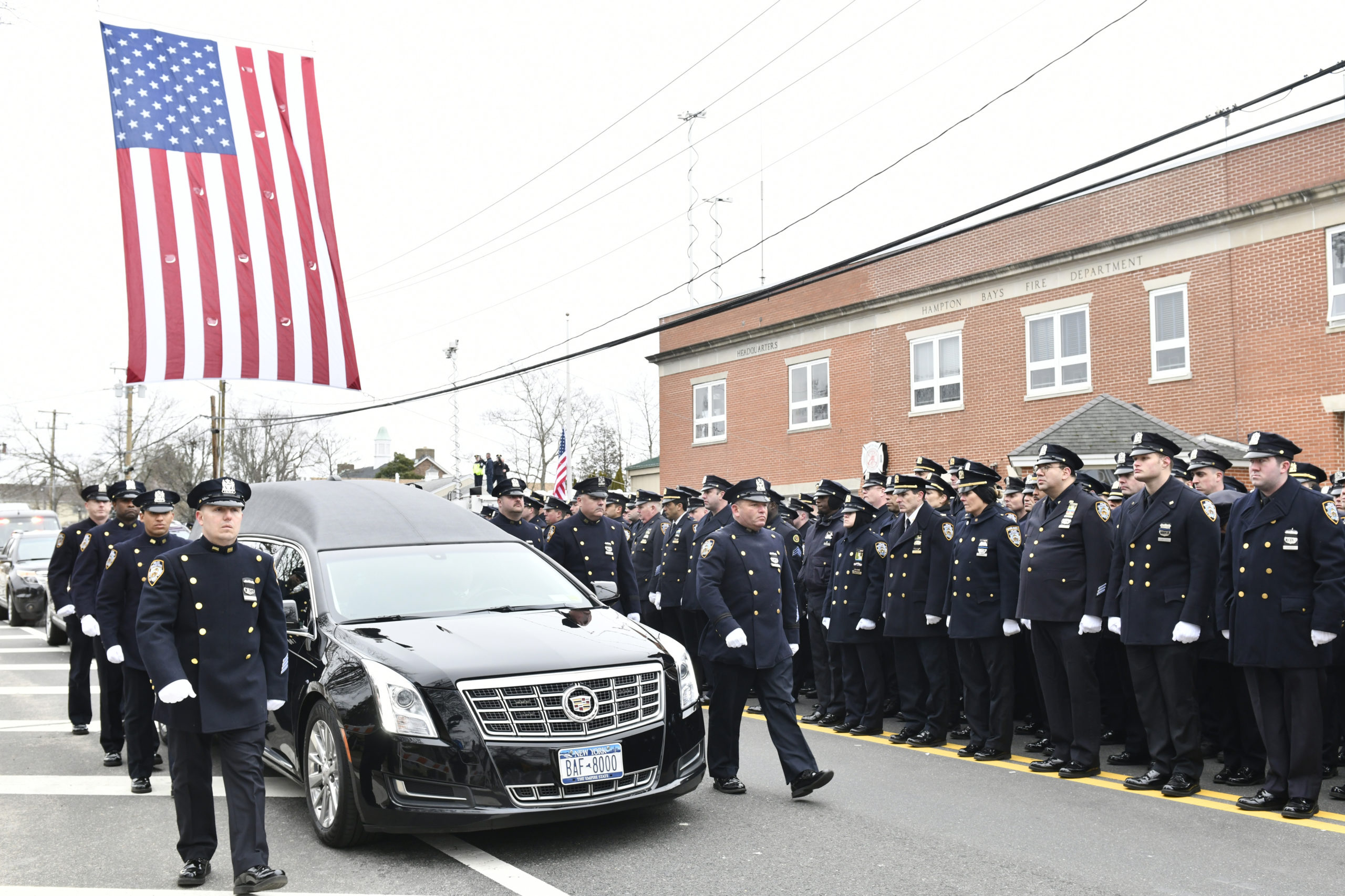Paying Respect January 21 -- Hundreds of police officers from departments across the country turned out on Wednesday for the funeral of New York Police Department Detective Brian Simonsen, 42, a Calverton resident, at St. Rosalie's Church in Hampton Bays. Det. Simonsen was killed on February 12 when he and six other officers responded to an armed robbery in Queens.