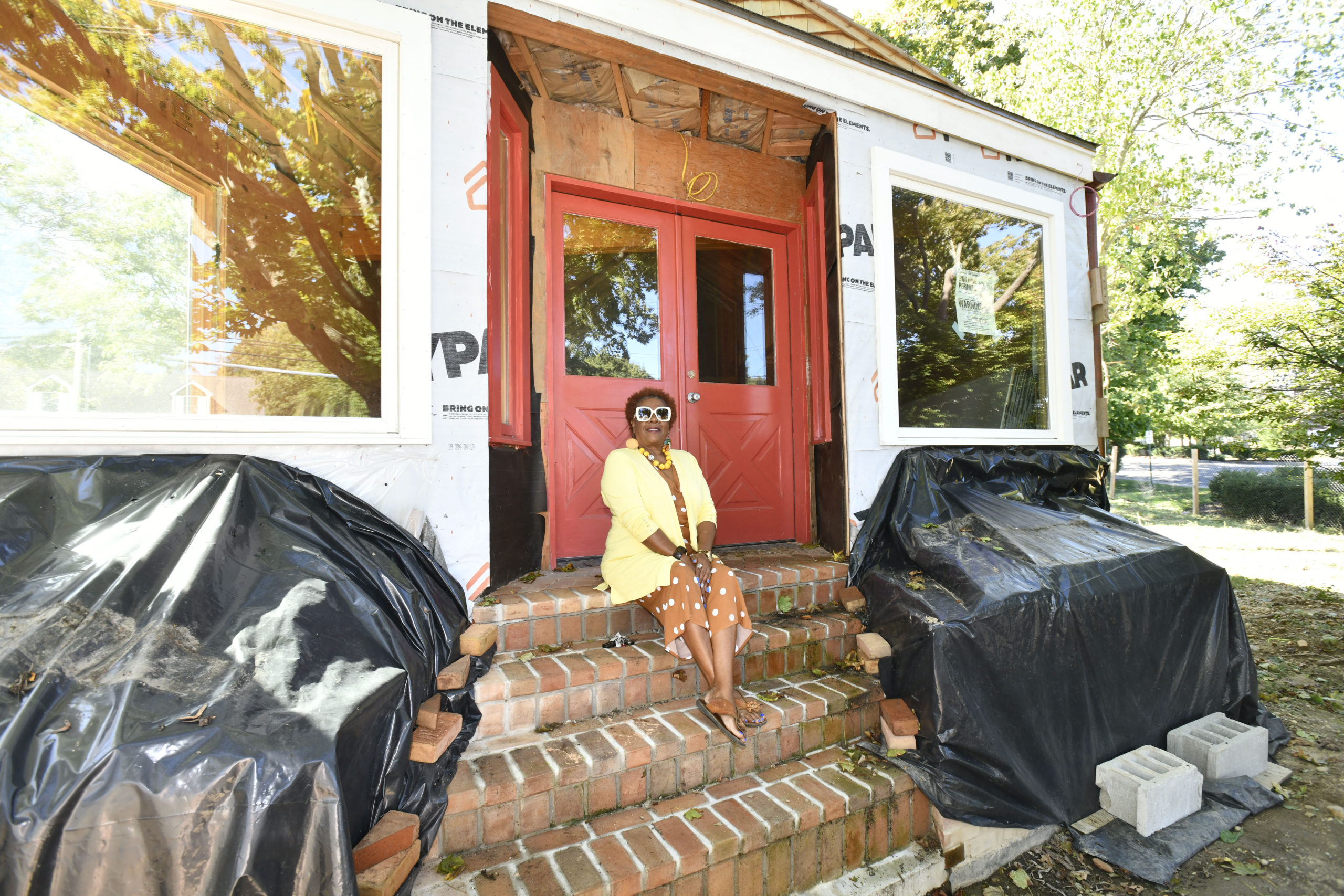 Museum Delays Test Patience October 10 -- Brenda Simmons is exhausted. That's the word she uses when she sits down to talk about the Southampton African American Museum, which was supposed to celebrate its grand opening in September on North Sea Road in Southampton Village. For months, work was being done on the building that used to house Randy's Barber Shop. But that work came to a halt, after it was discovered that the contractor, William Proefriedt of West Babylon, may have falsified documents in his bid to restore the Pyrrhus Concer House on Pond Lane. He's currently facing felony criminal charges, and was removed from both the Concer House and SAAM projects, both of which are now sitting unfinished, waiting for the next step. Mr. Proefriedt was more than halfway through the work that needed to be done to transform the old barber shop — which was designated as the first African-American historic landmark in Southampton Village in 2010 — into the museum, but the work he did was not up to par, according to both Ms. Simmons, architect Siamak Samii, and officials from LK McLean, the firm that oversees Community Preservation Fund projects. The town is now in the process of preparing to put out a bid again to complete the project, but the work likely won't be completed until the spring, at the earliest