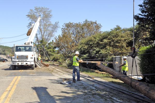 Crews work to repair downed power lines on Montauk Highway in Shinnecock Hills.  DANA SHAW