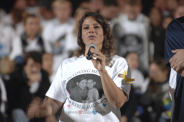 Family cousin Danielle Chavez speaks about Keri and Jason Trinca at the memorial at Eastport South manor High School on Tuesday night.